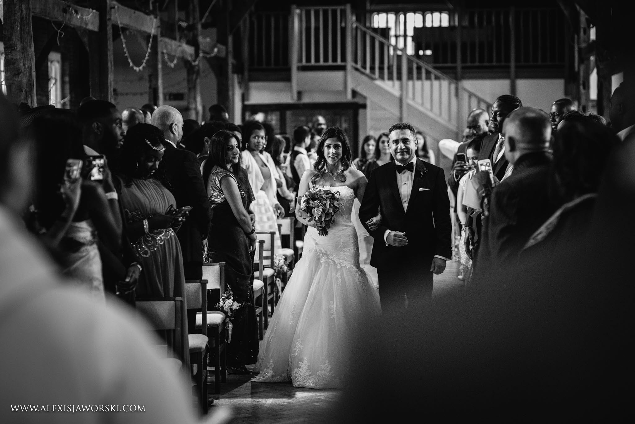 bride and brother walking down the aisle