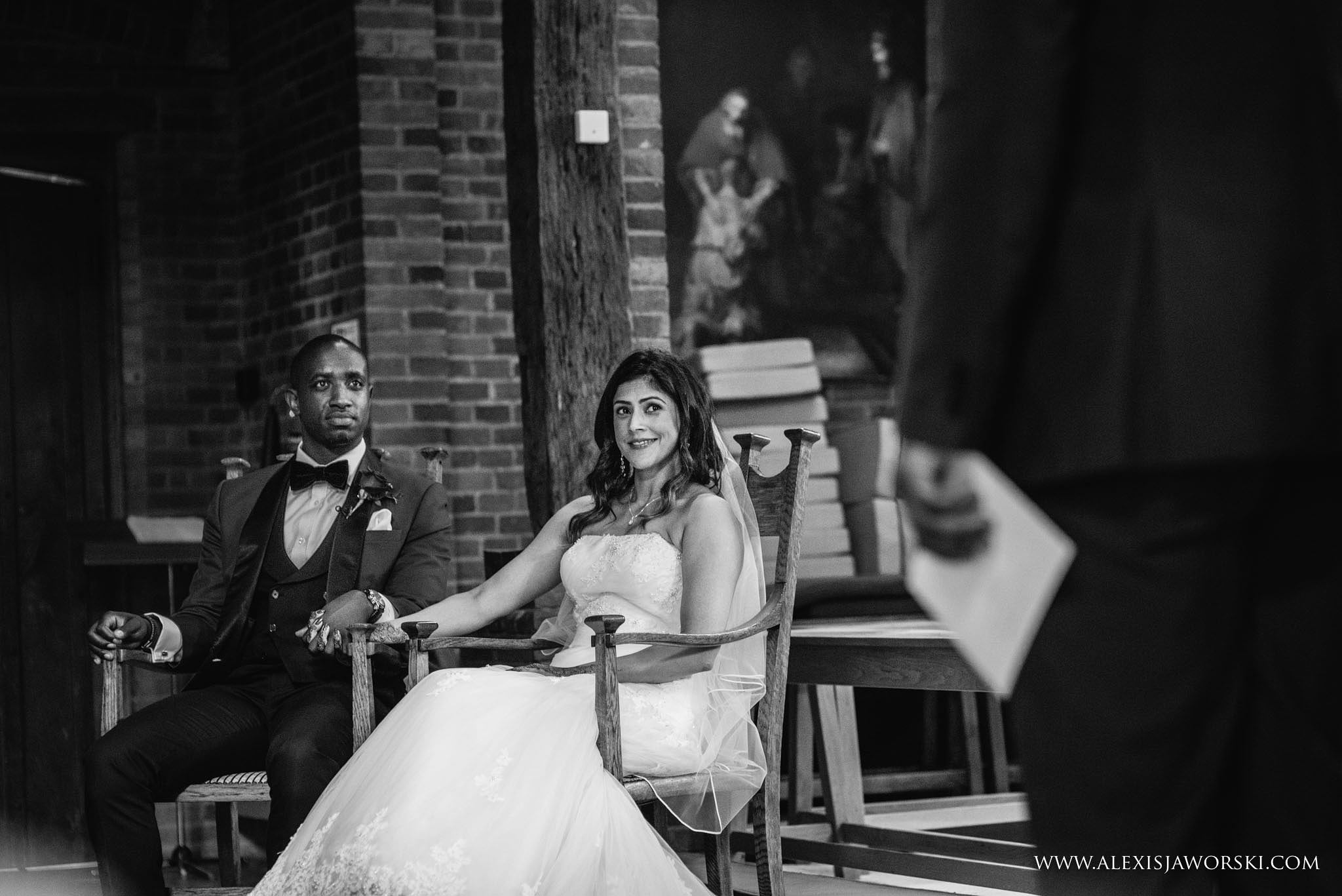 bride and groom listening to speches