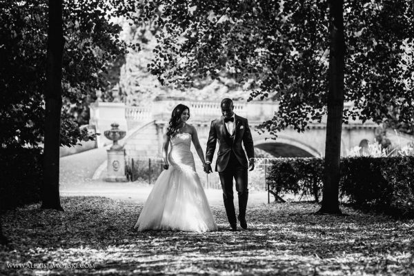 bride and groom walking in lovely light by trees