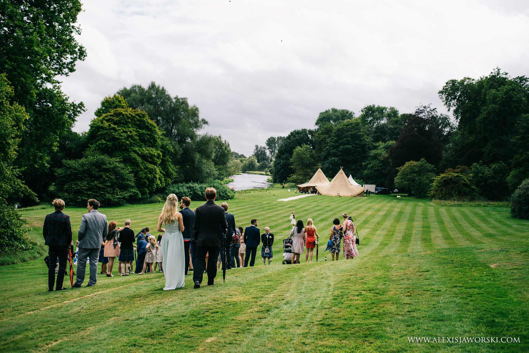 guests walking from main house to tipi