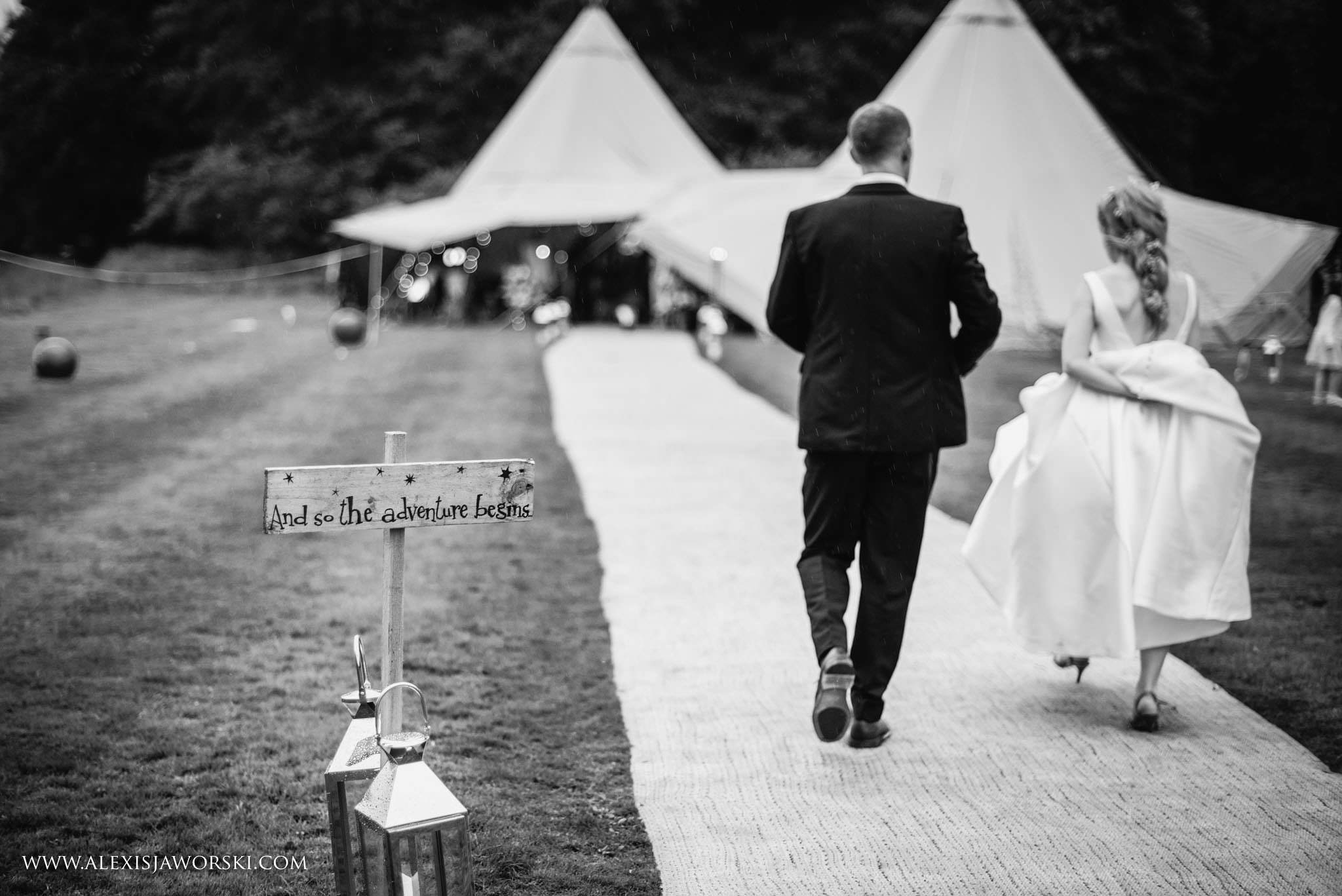 bride and groom walking back to tipi
