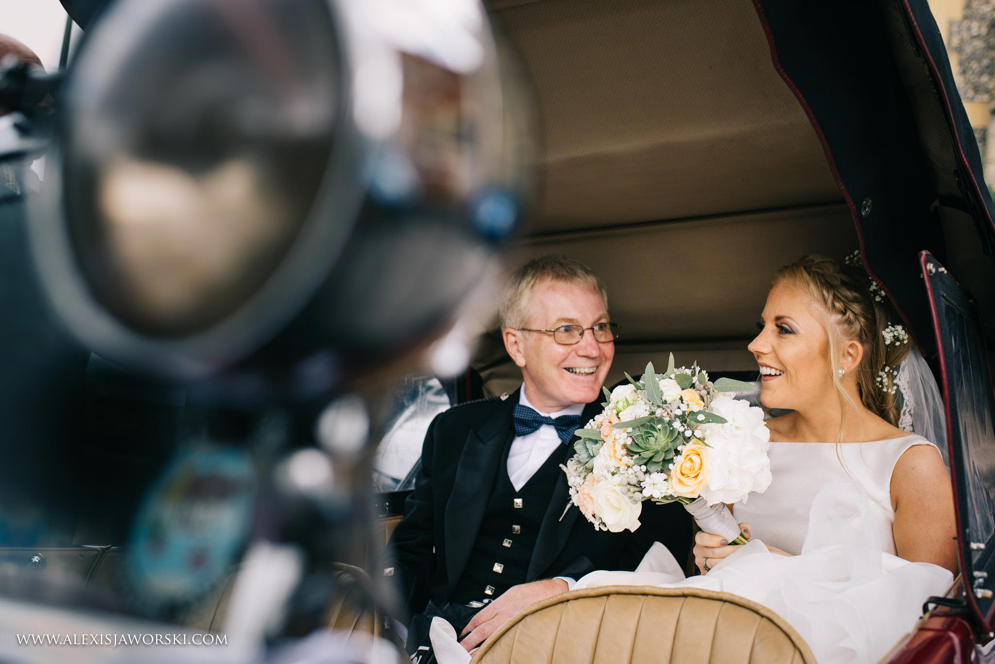 bride in bridal car with dad