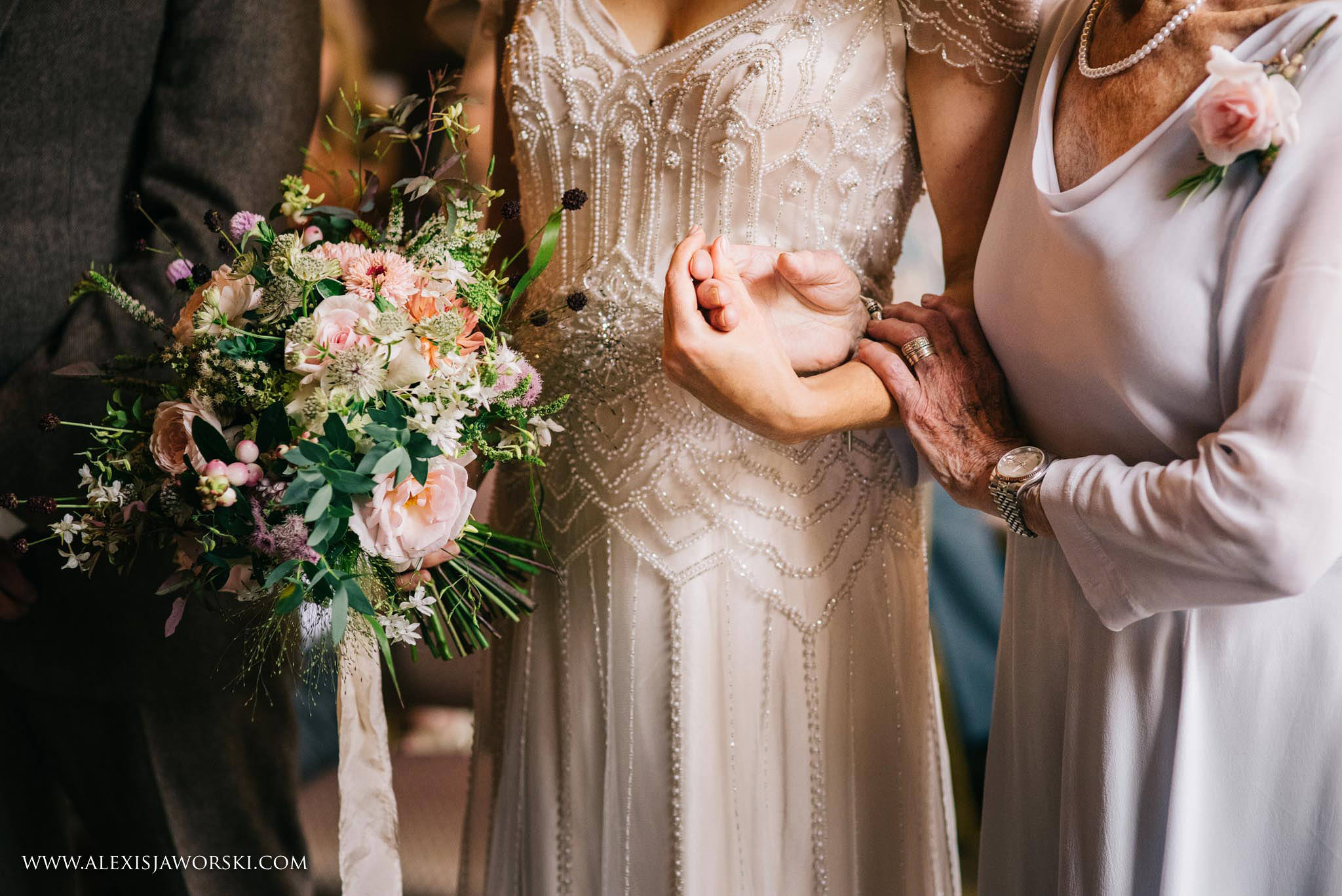 bride hugging relative's hand