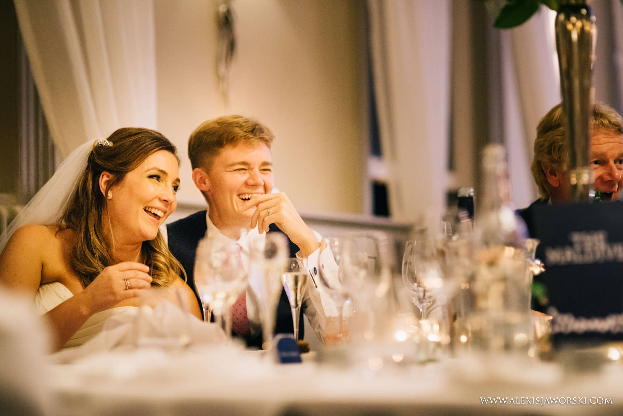 bride and groom listening at speeches