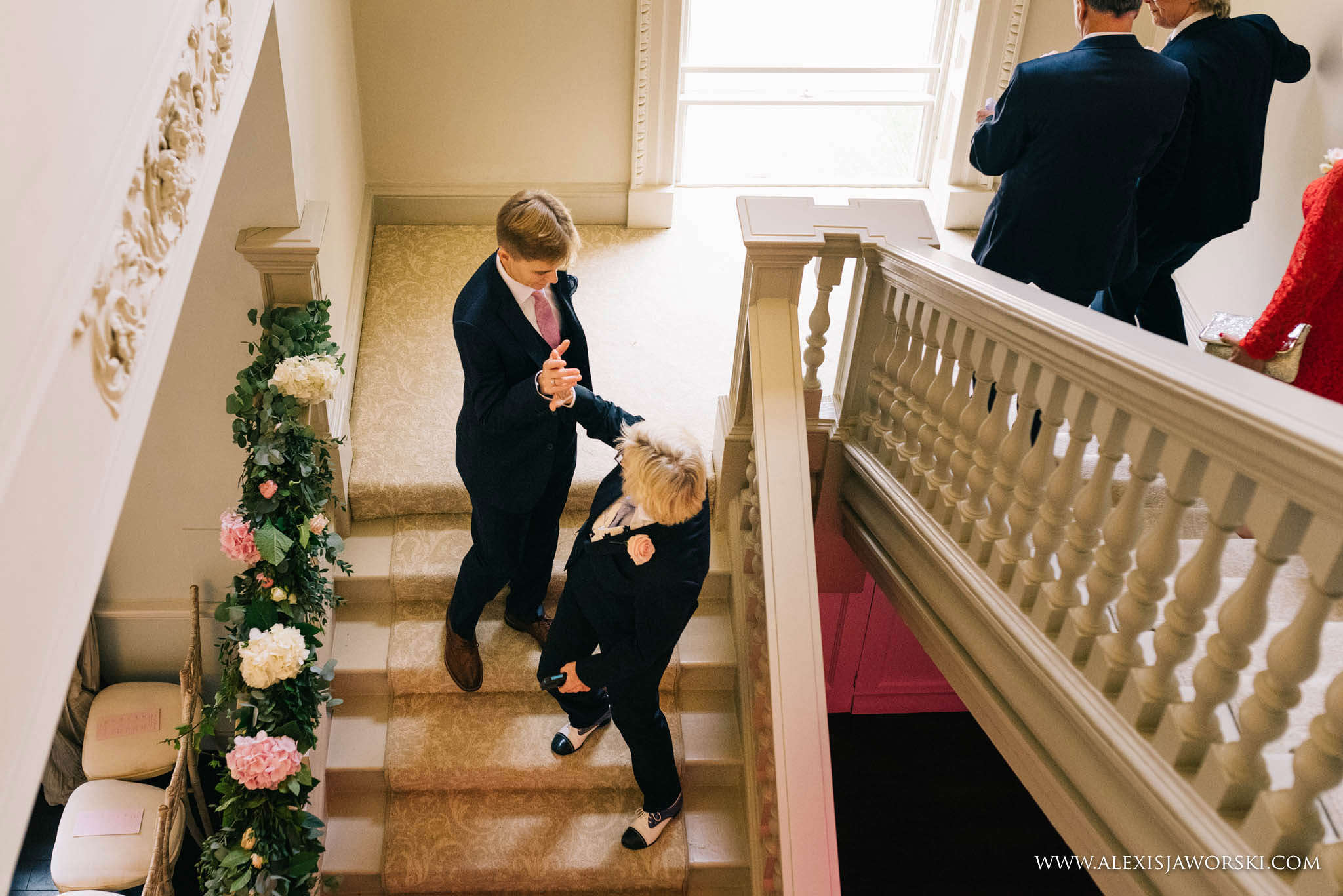 groom waiting on the steps