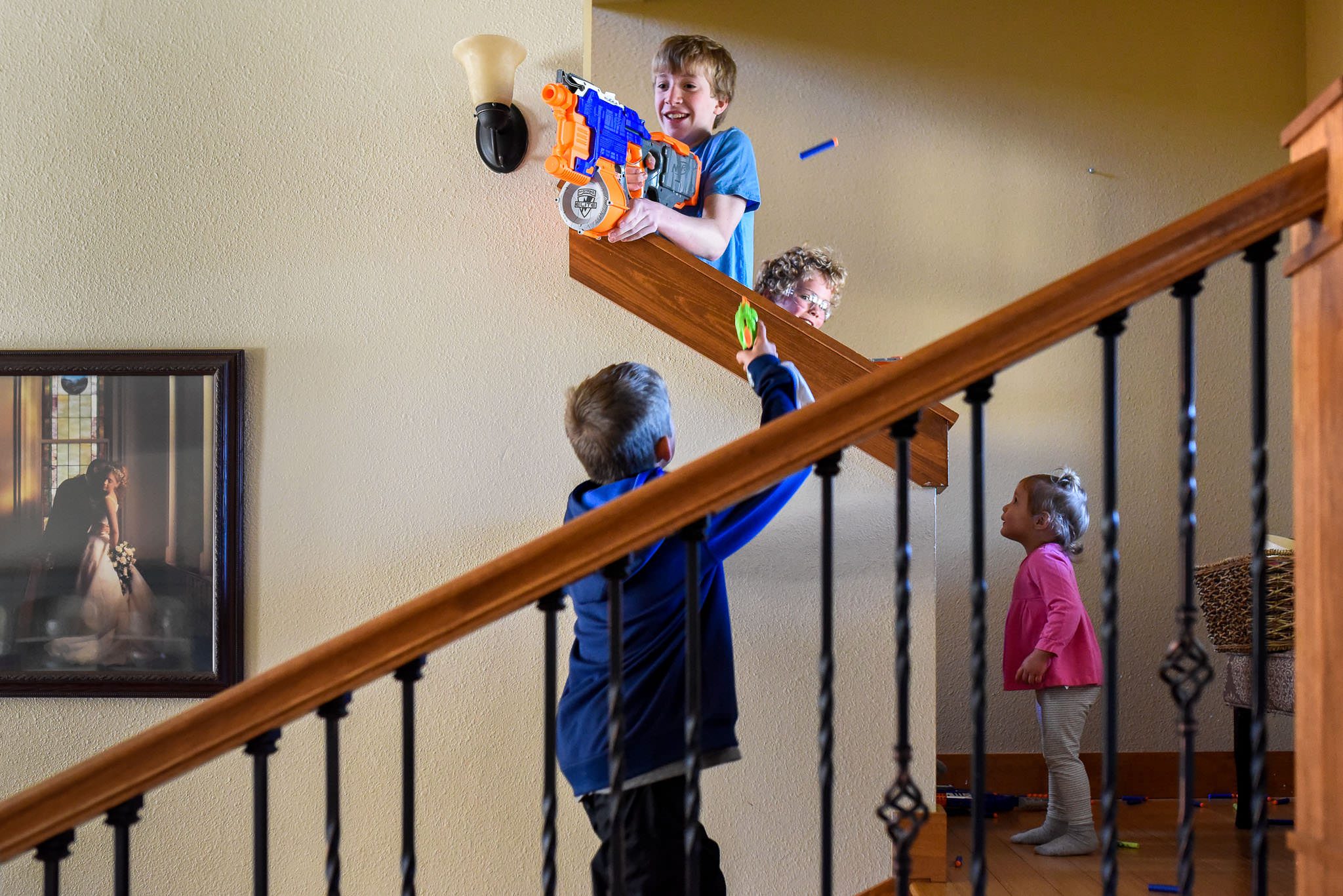 Children photography playing with nerf guns