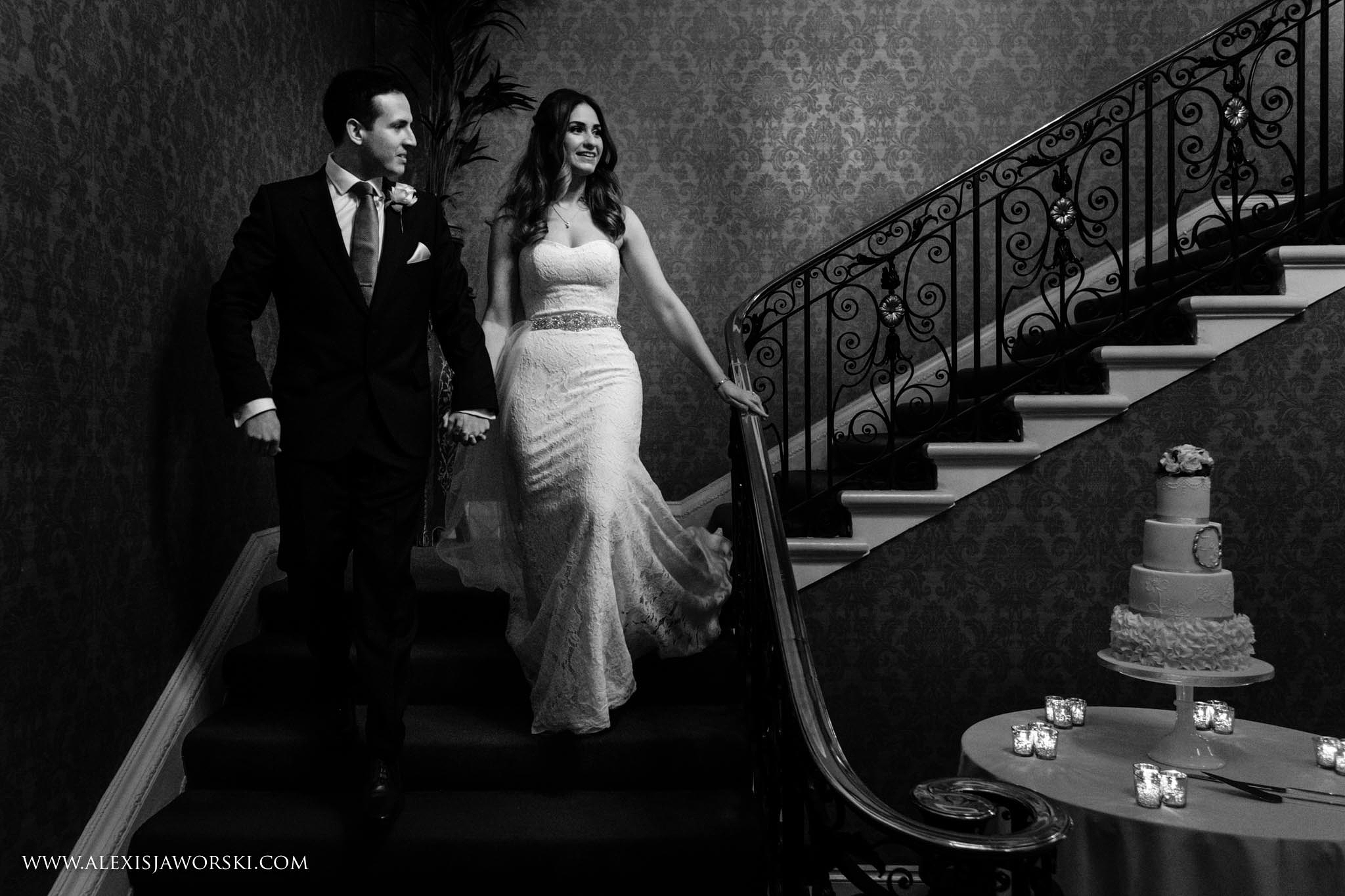 bride and groom coming down the stairs