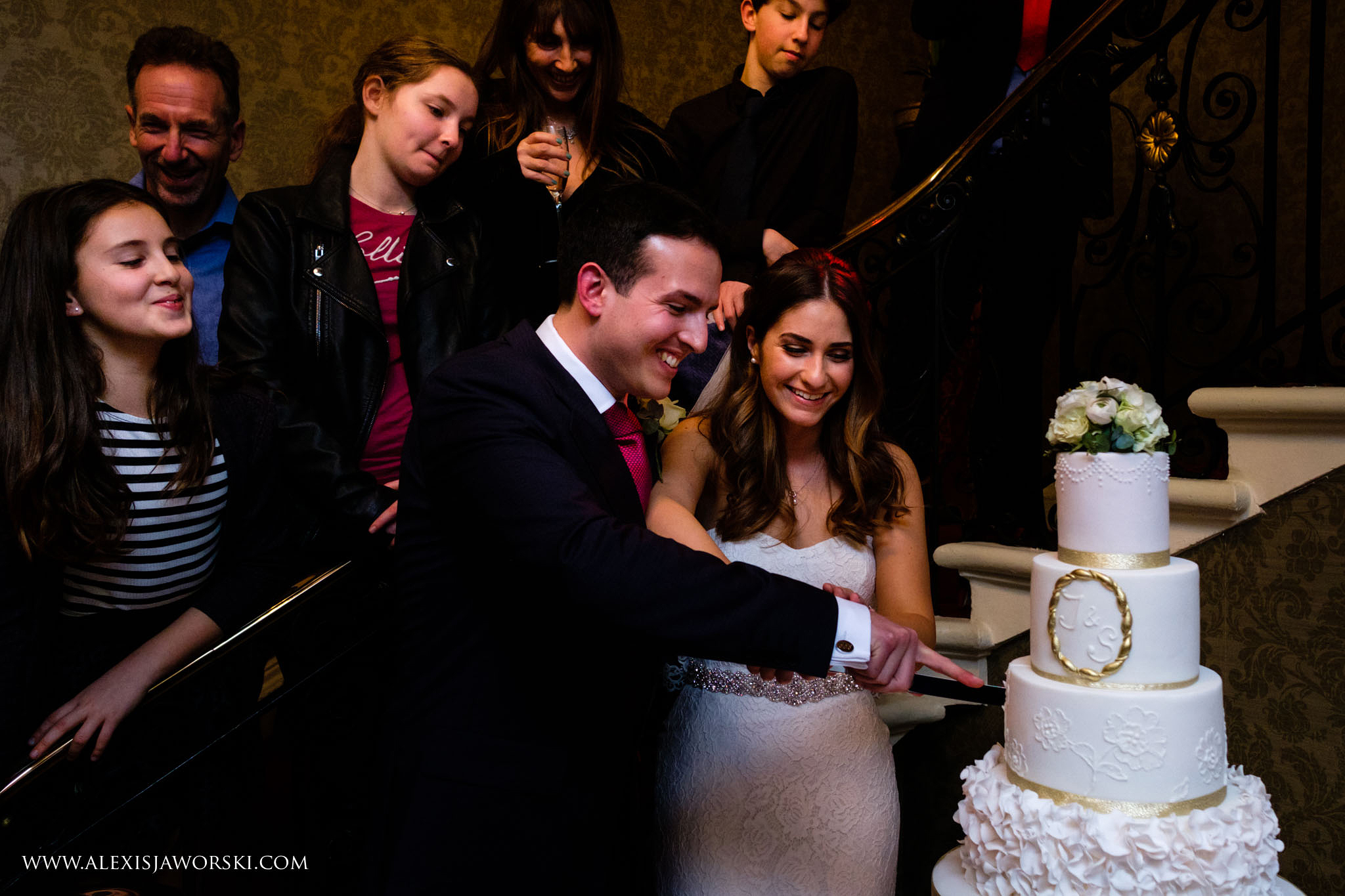 cutting of the cake by the stairs