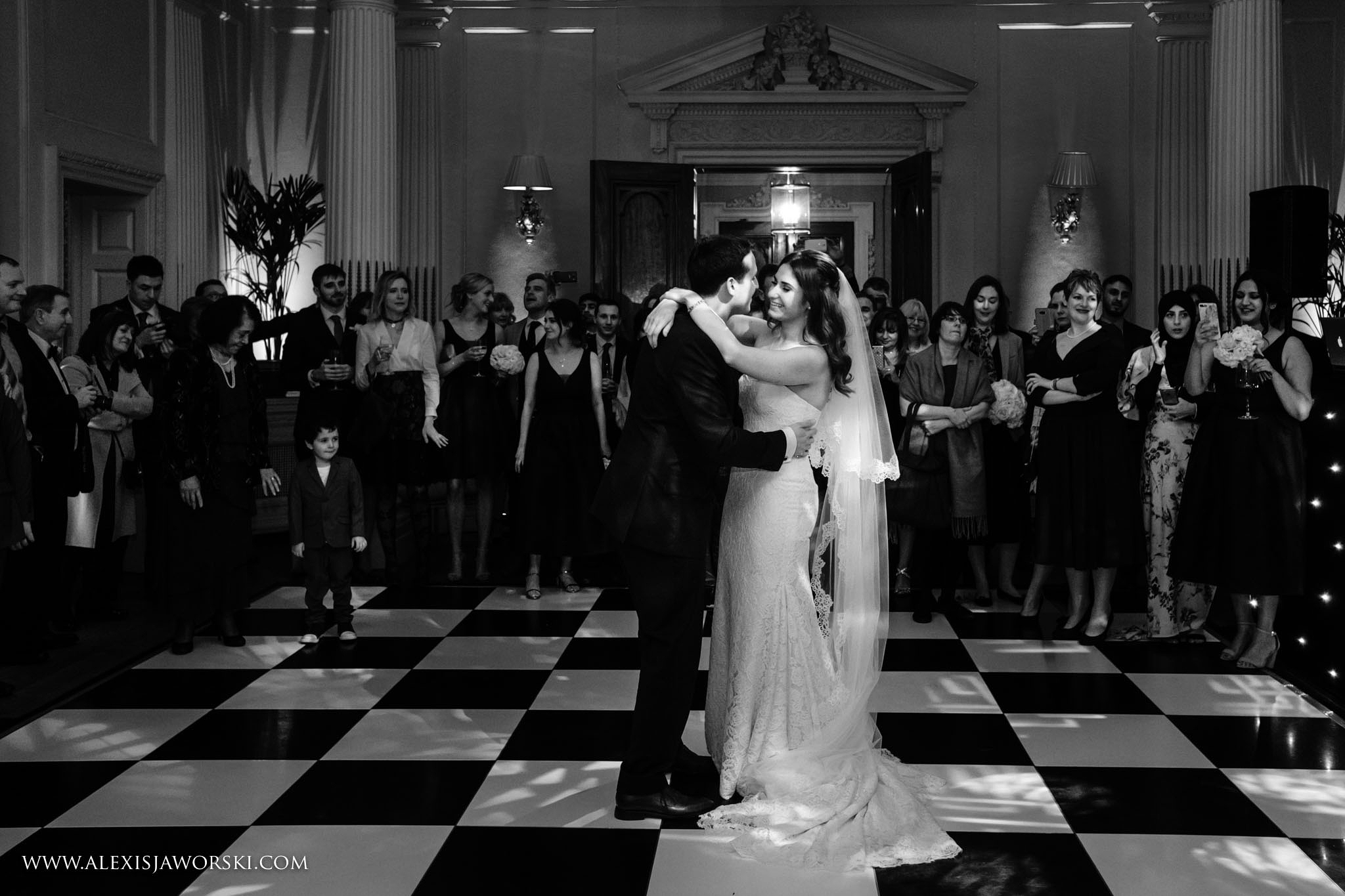 bride and groom dancing in black and white