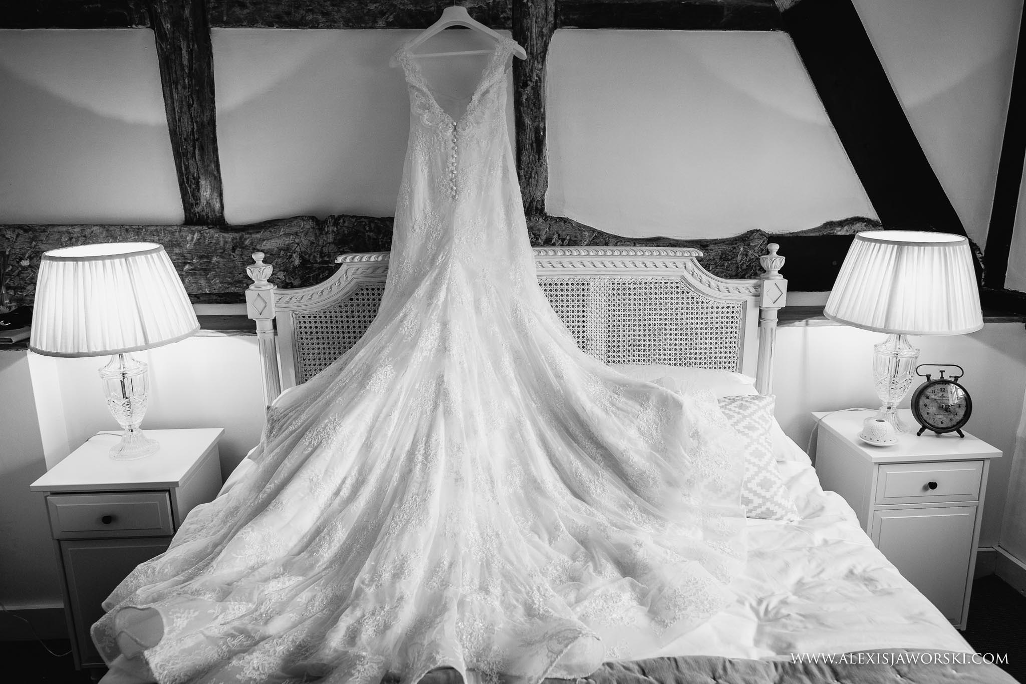 wedding dress over bed