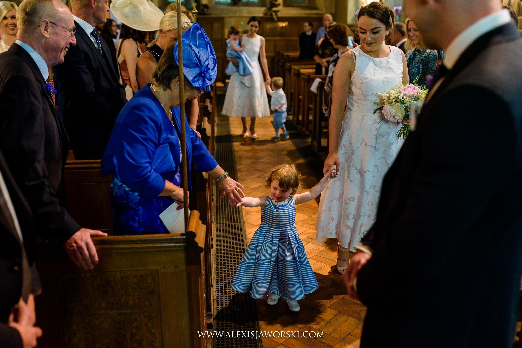 daughter of groom walking down the aisle