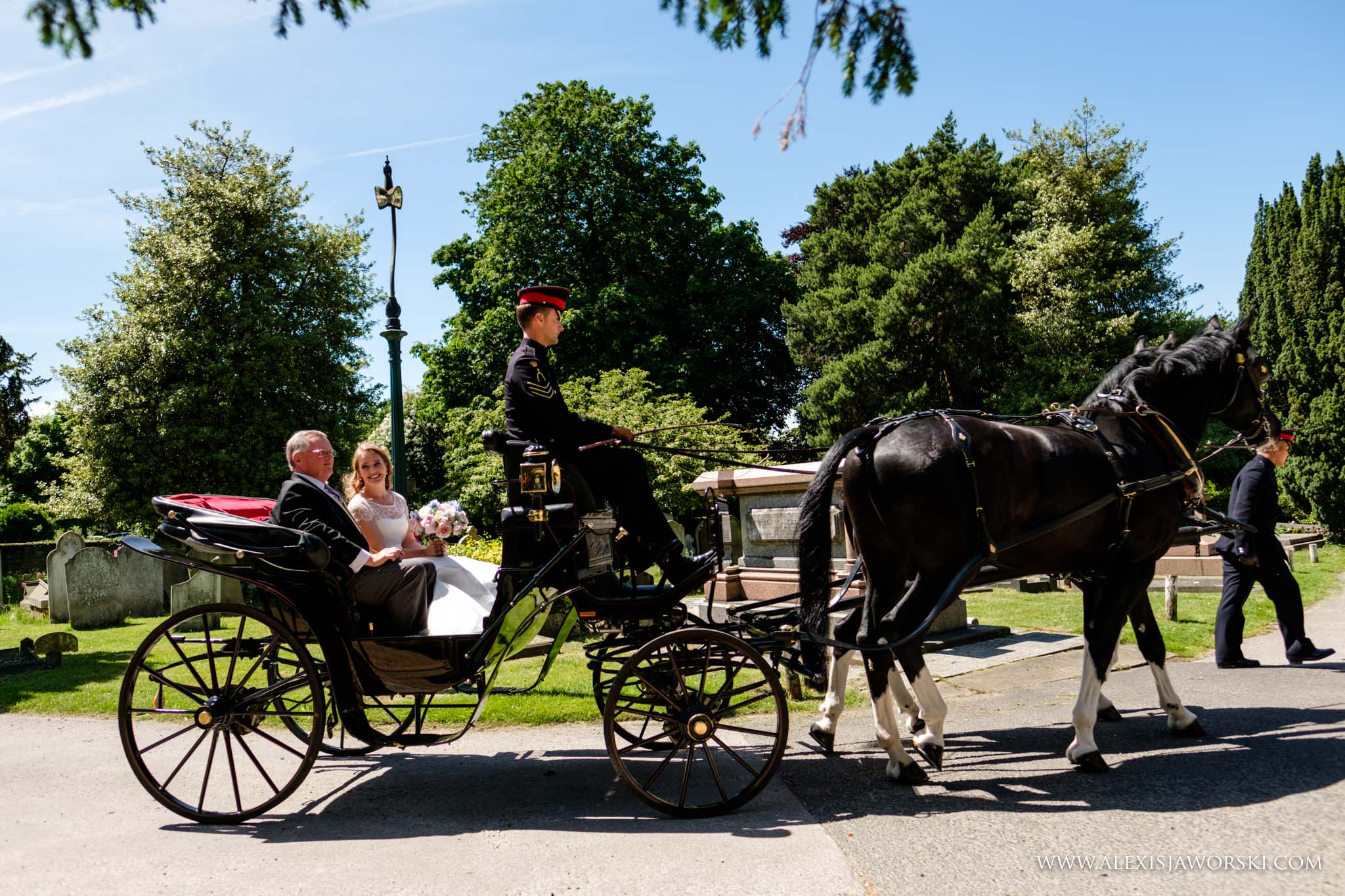 bride arriving in horse carriage