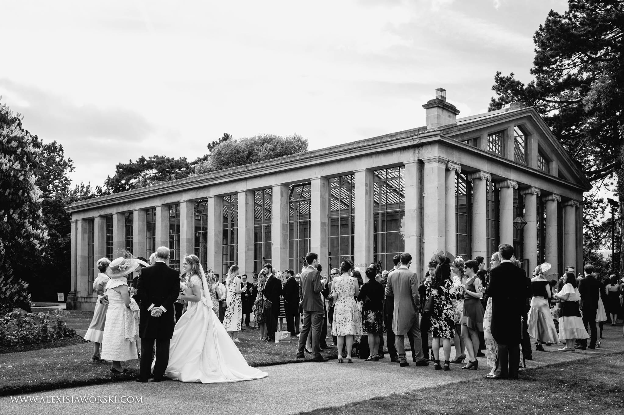 view of the Nash Conservatory with bride and guests