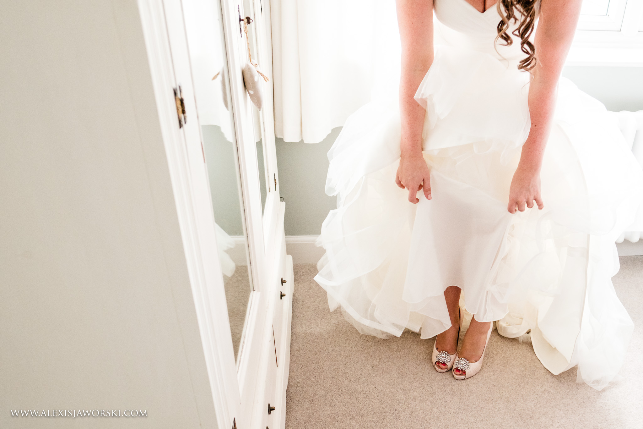 bride getting ready in her shoes
