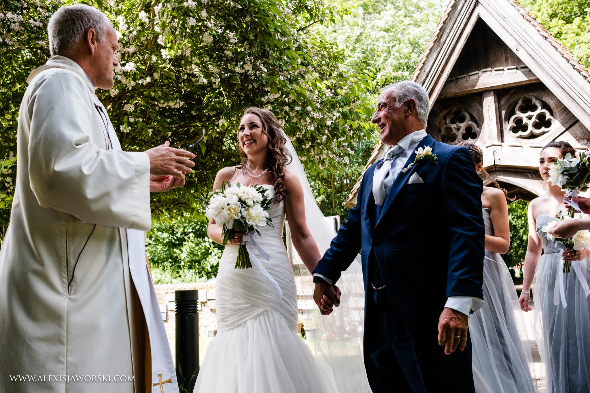 bride and priest saying hello