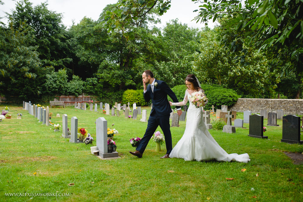 groom kissing gravestone