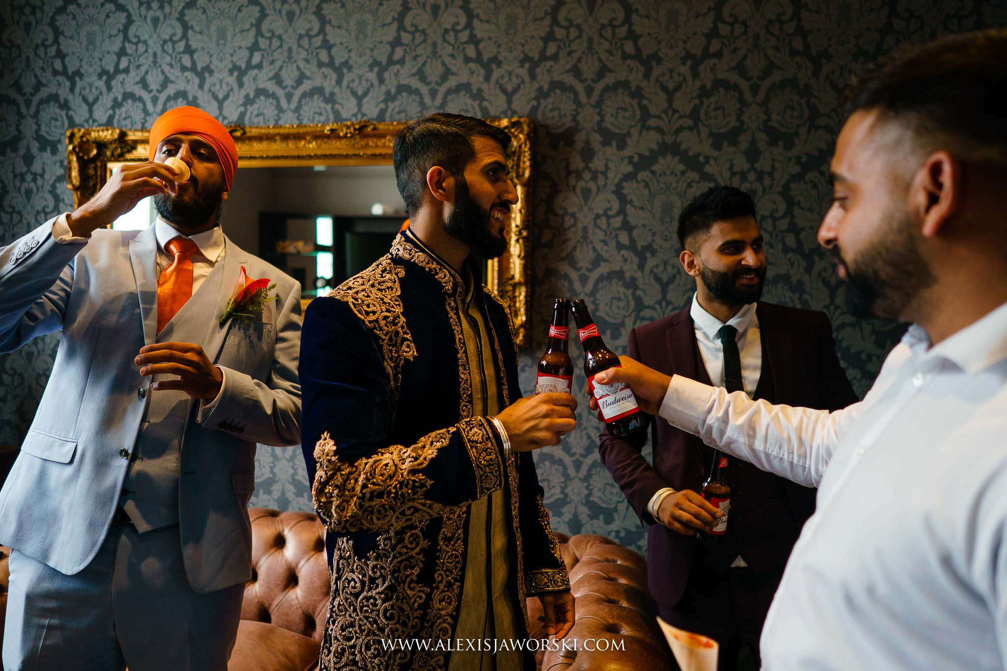 groom cheering with guests