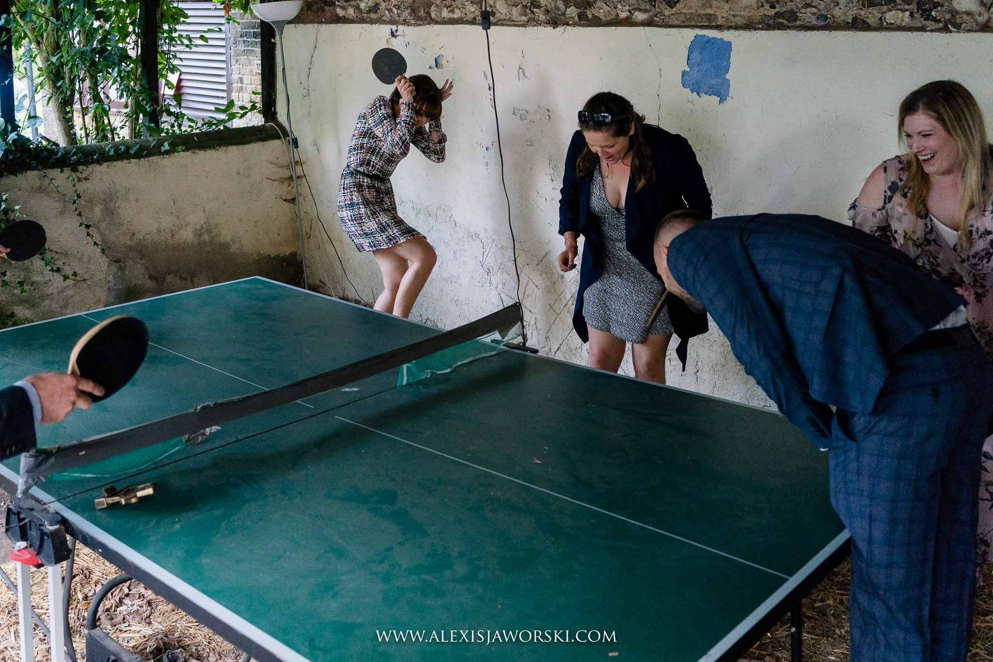 guests playing ping pong
