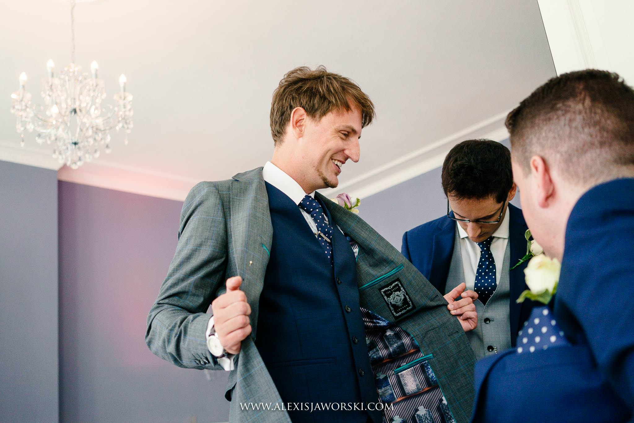 groom showing off his jacket