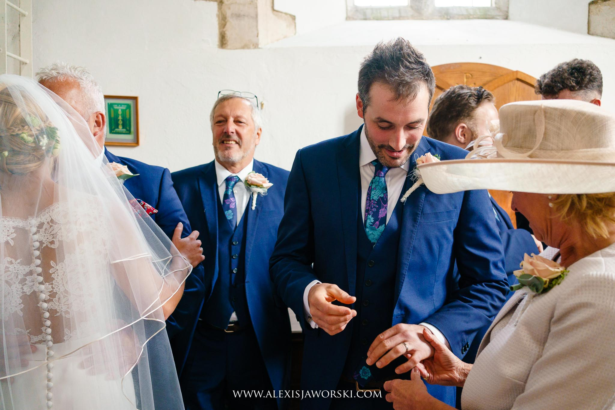 The groom showing the wedding ring