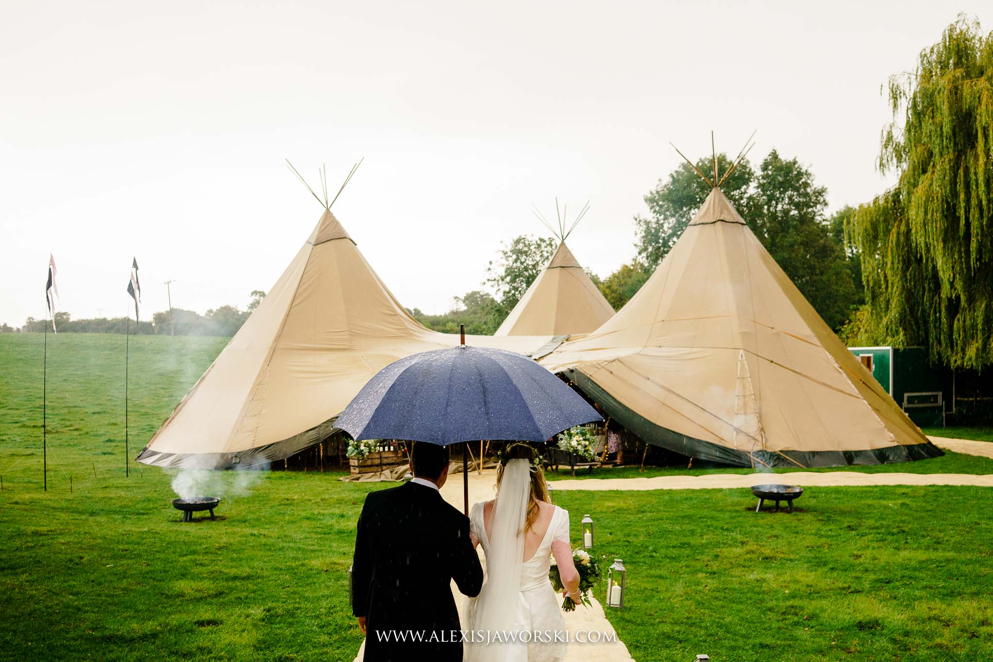 bride and groom arriving at teepee