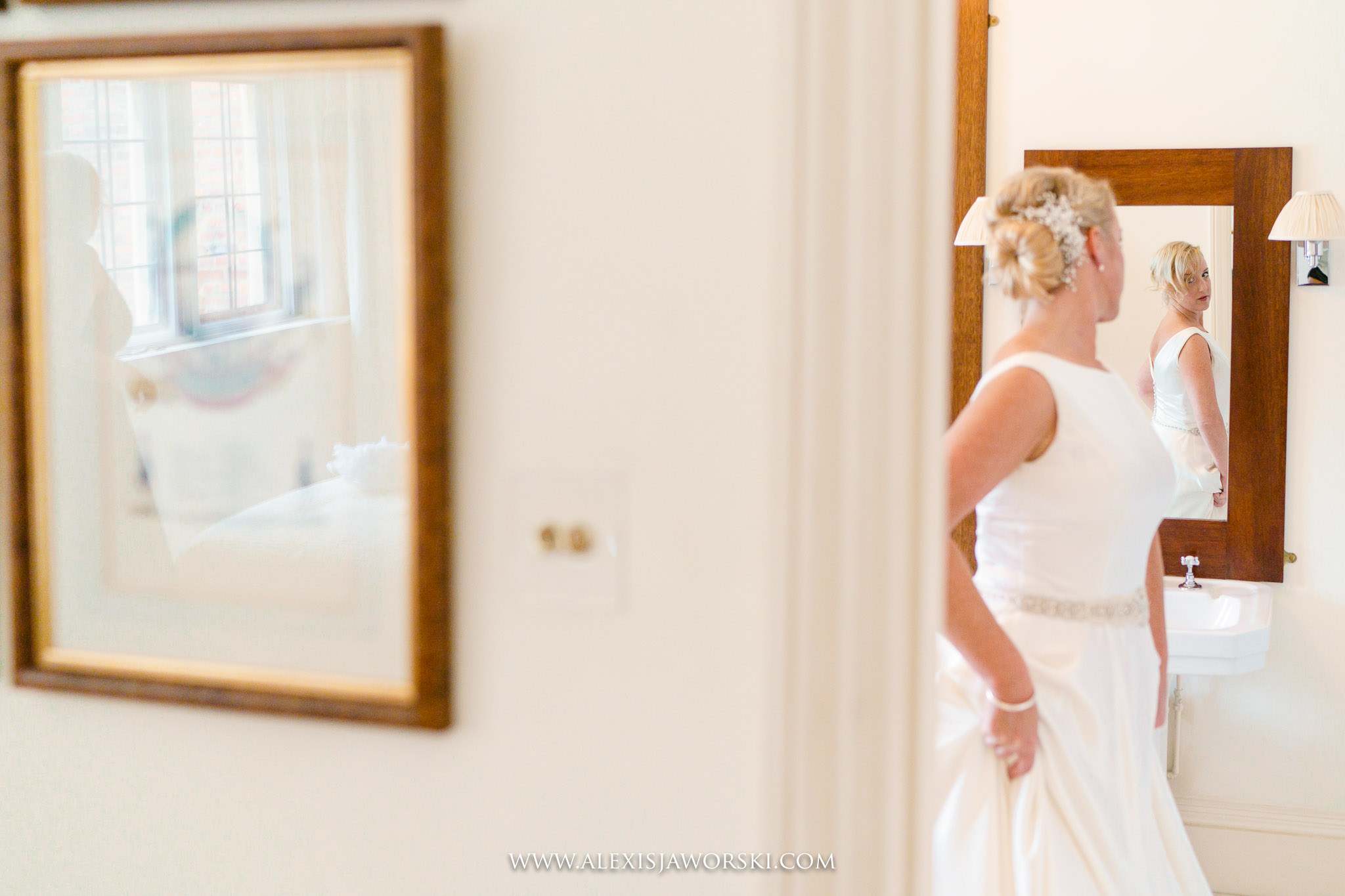 bride looking at the wedding dress
