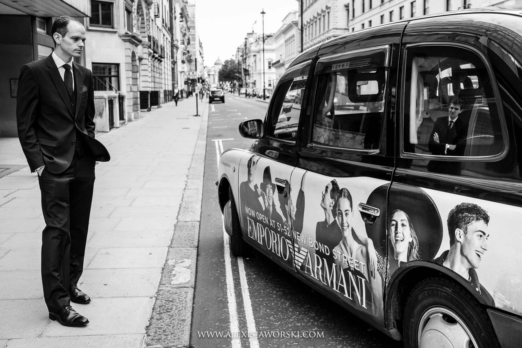 grabbing taxi to venue