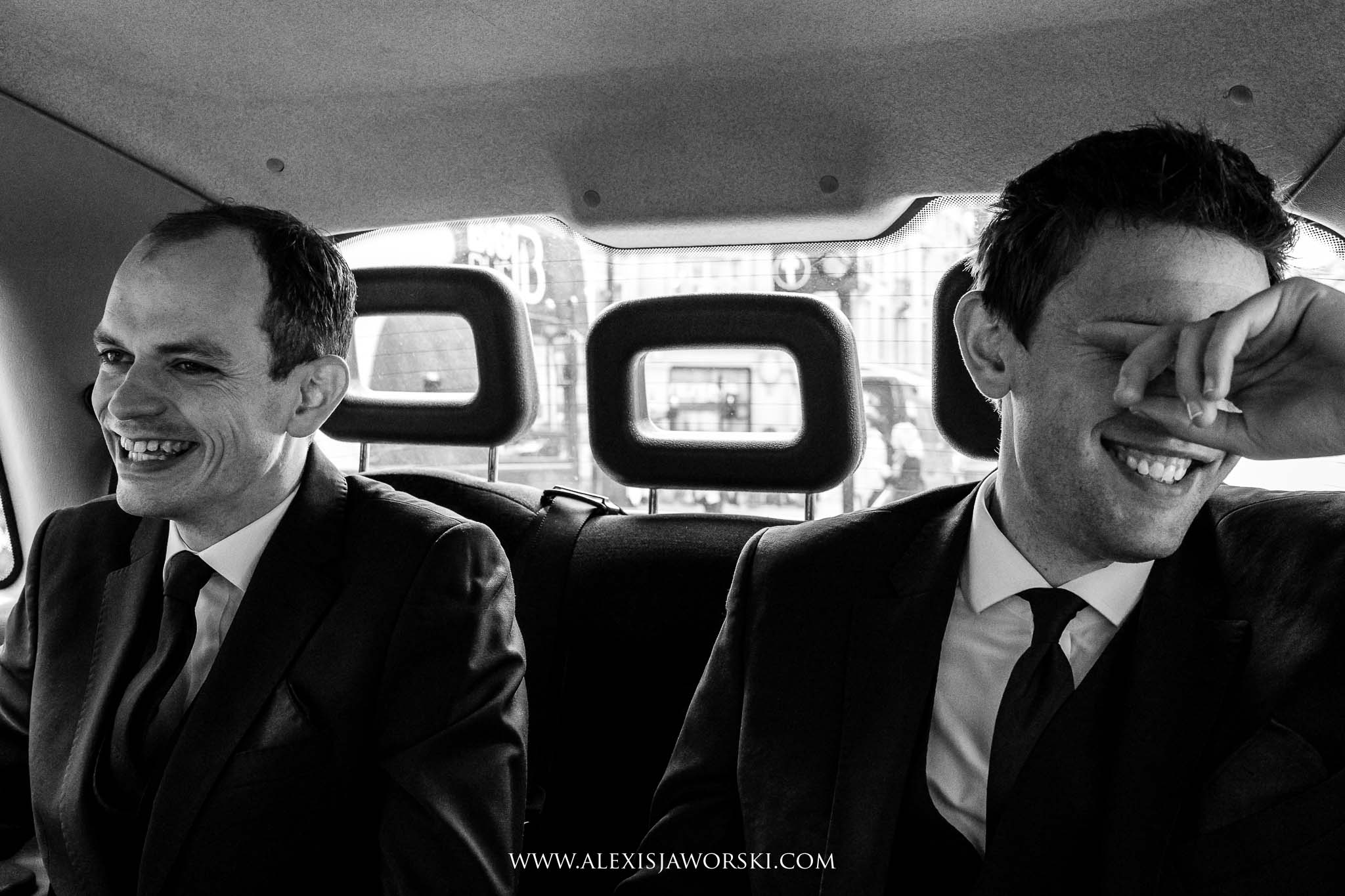 groom and best man in cab