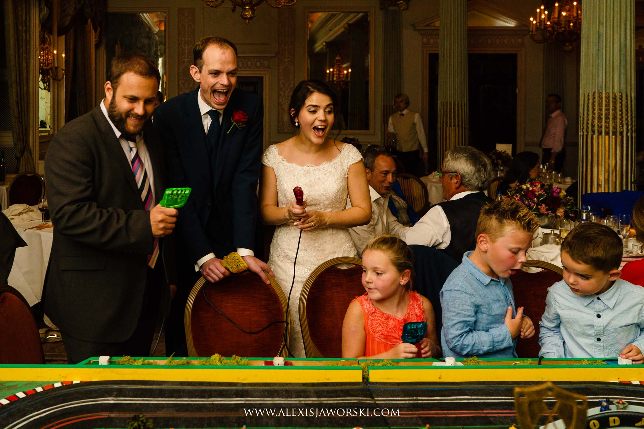 bride and groom playing Scalextric
