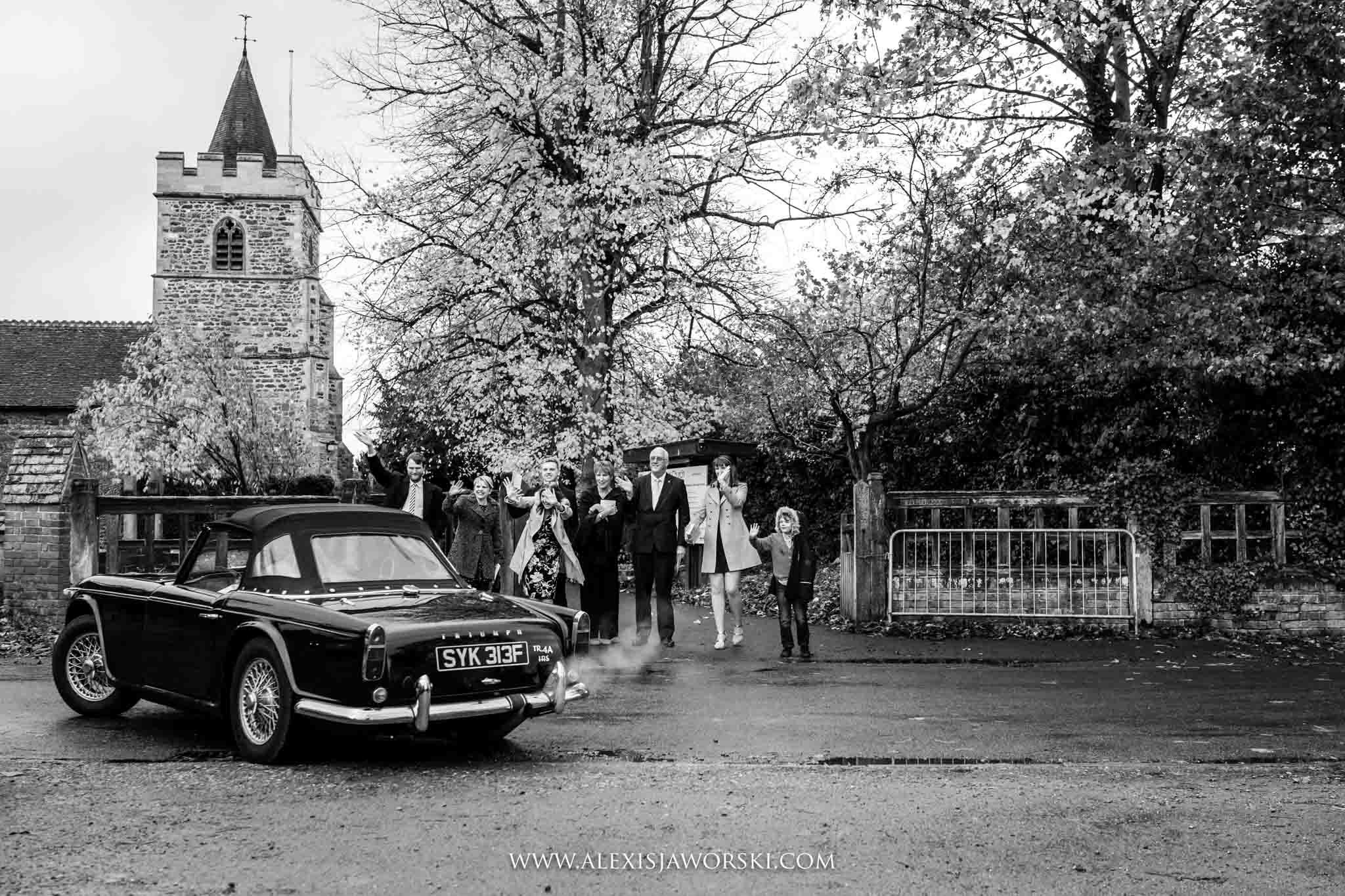 bride and groom leaving in vintage car