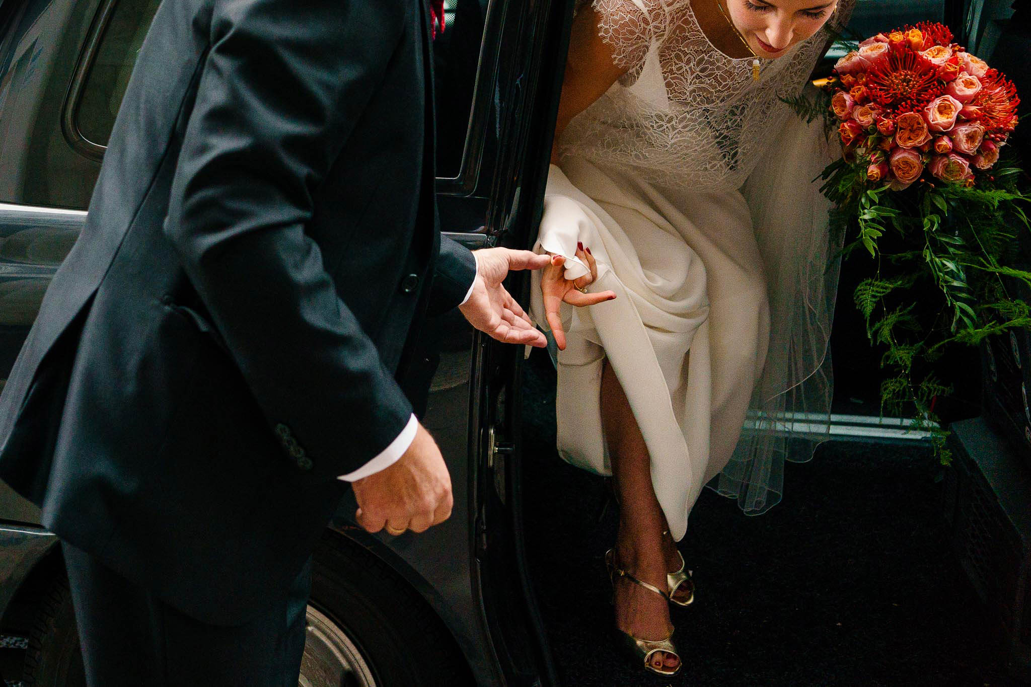 bride stepping out of car