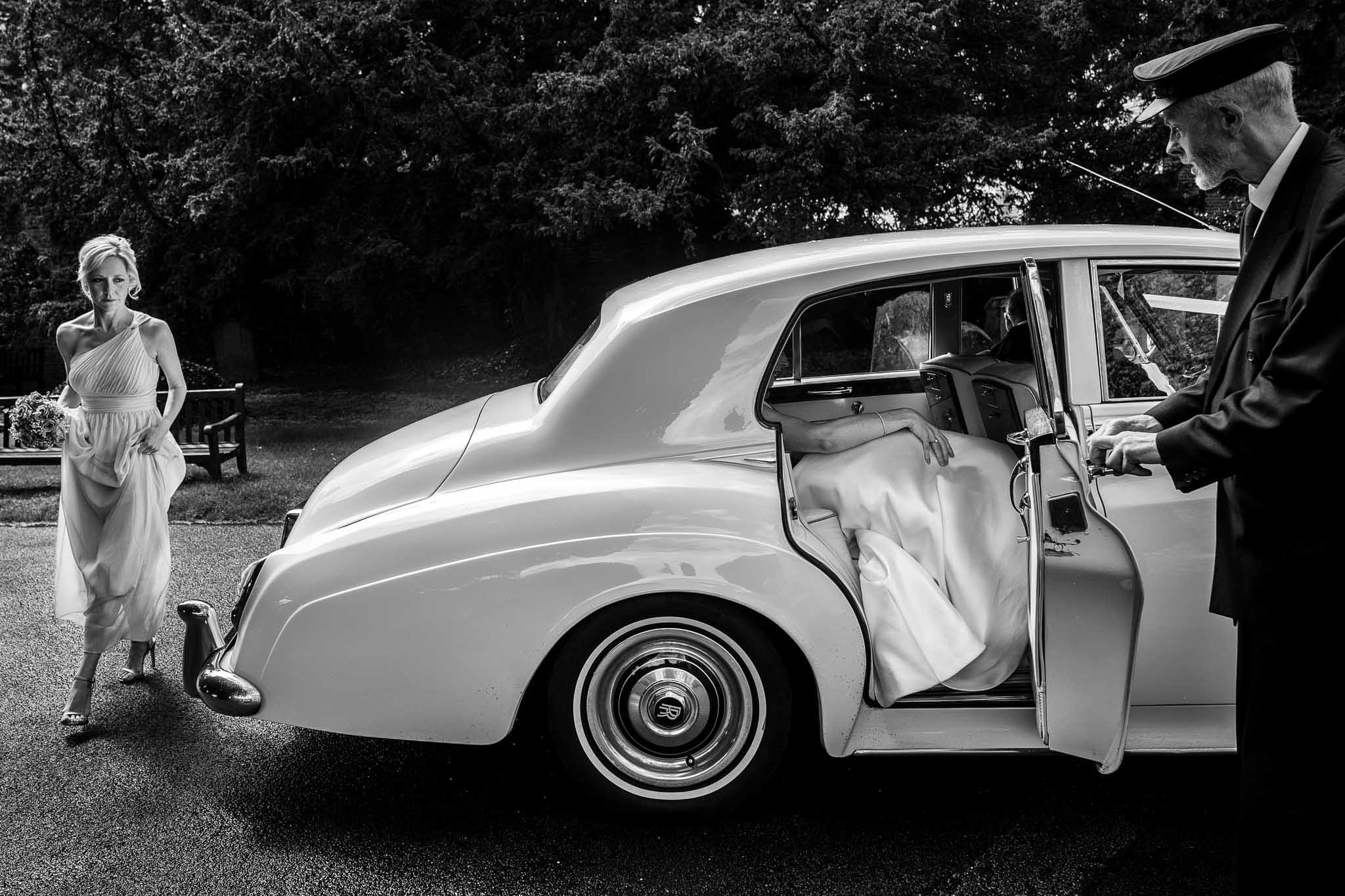 bride stepiing out of car