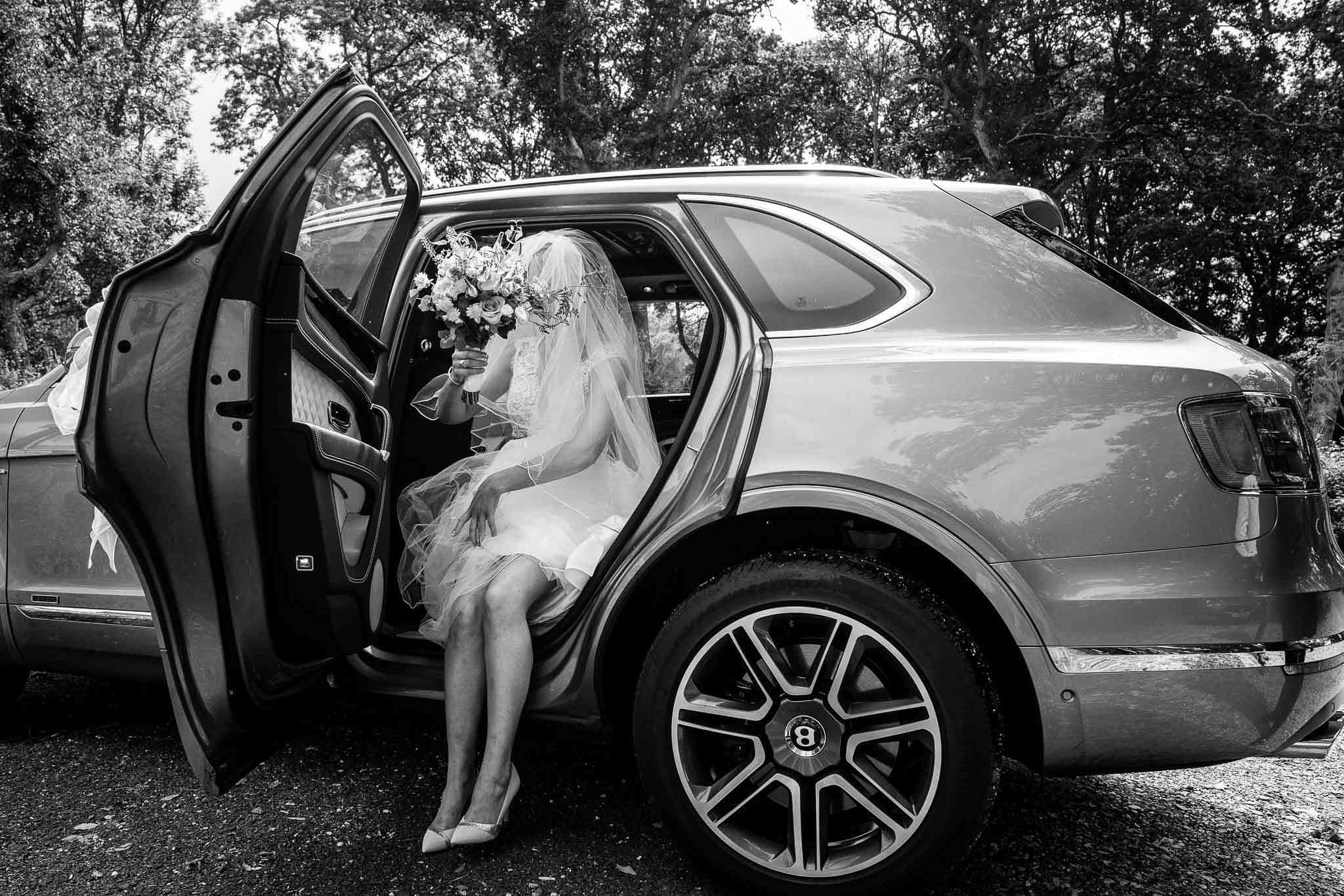bride steeping out of car