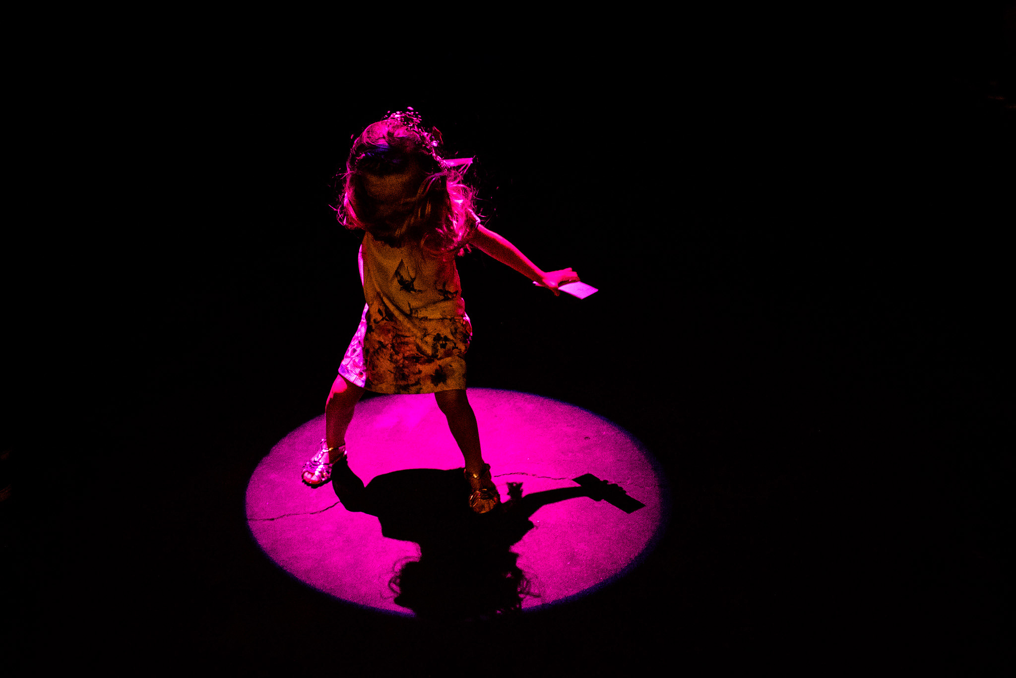 girl dancing on spot light