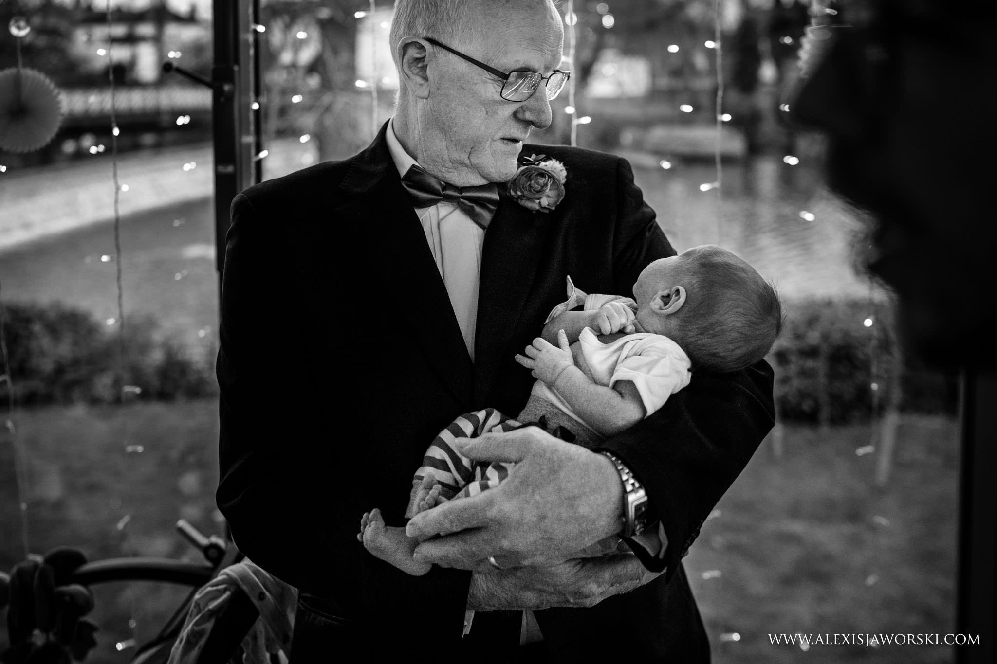 grandpa holding baby