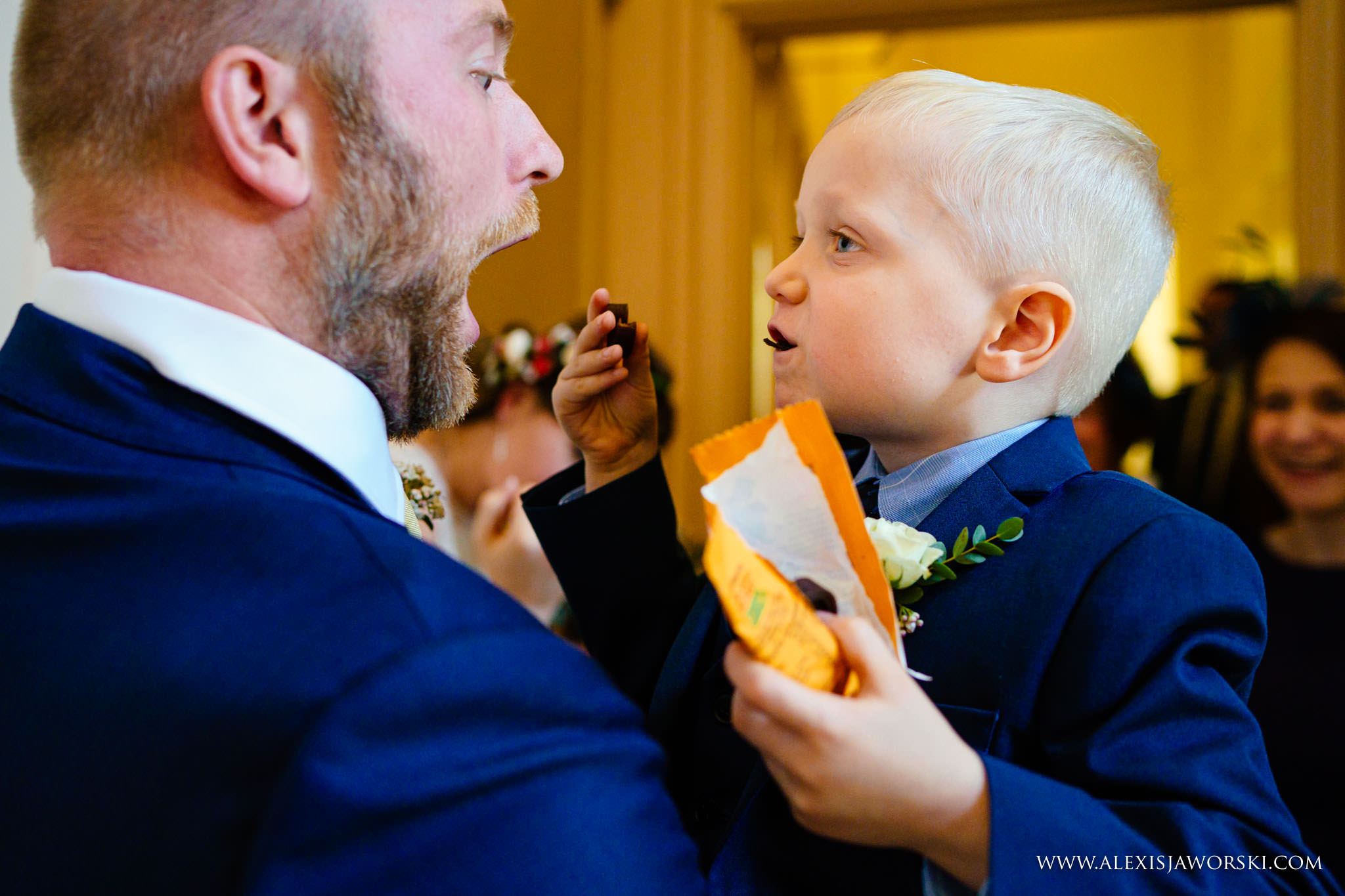 groom and page boy playing