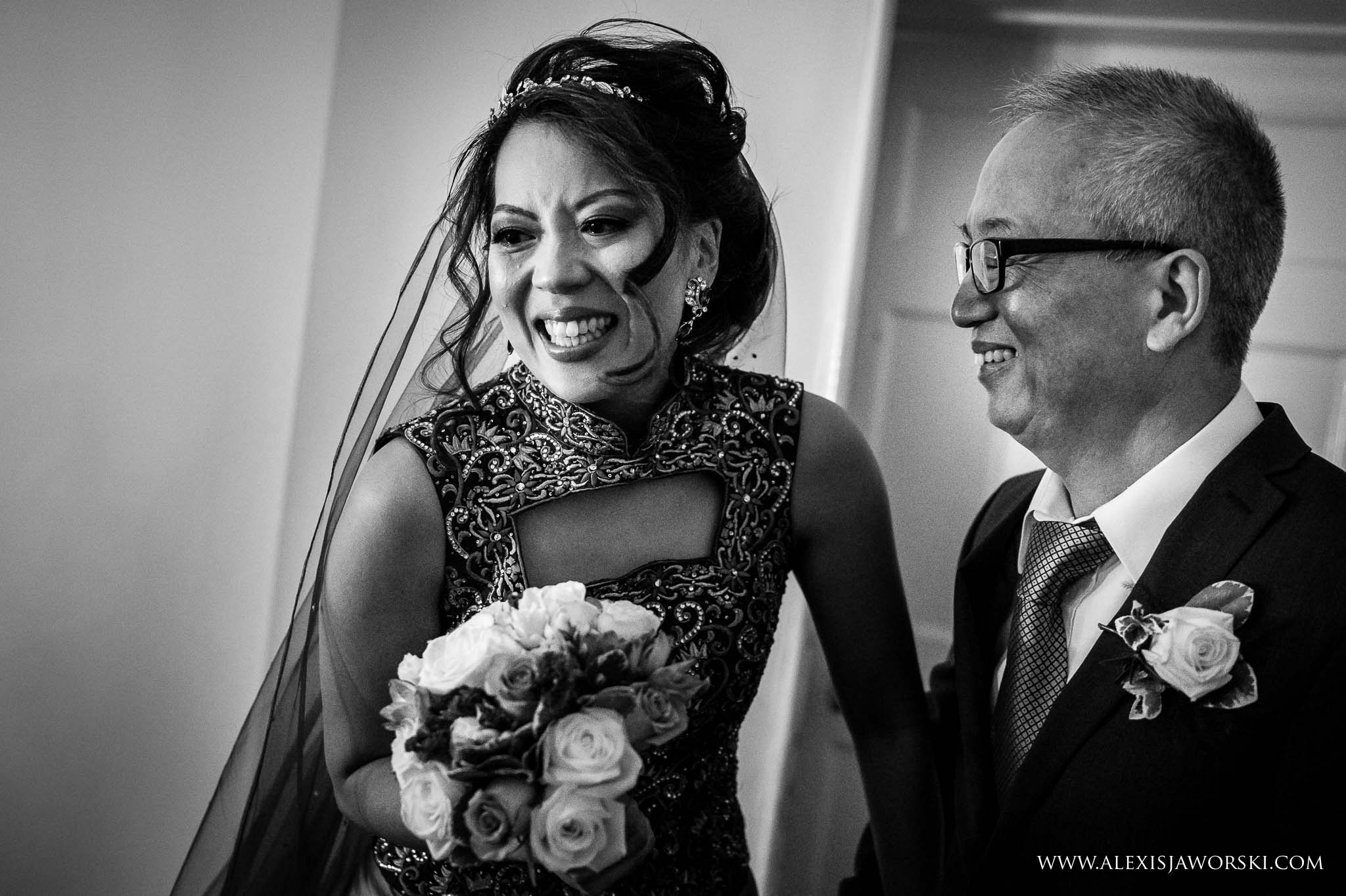 emotional bride with father