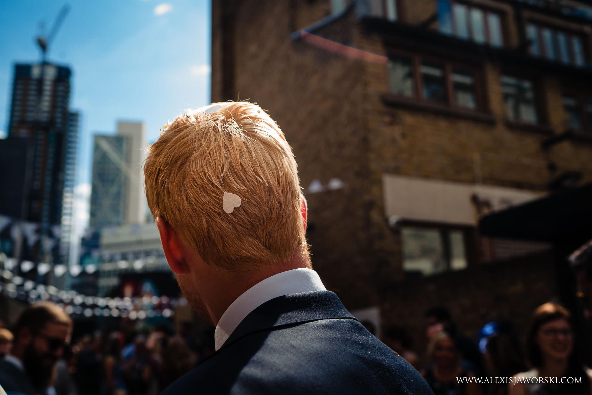 confetti on groom's head
