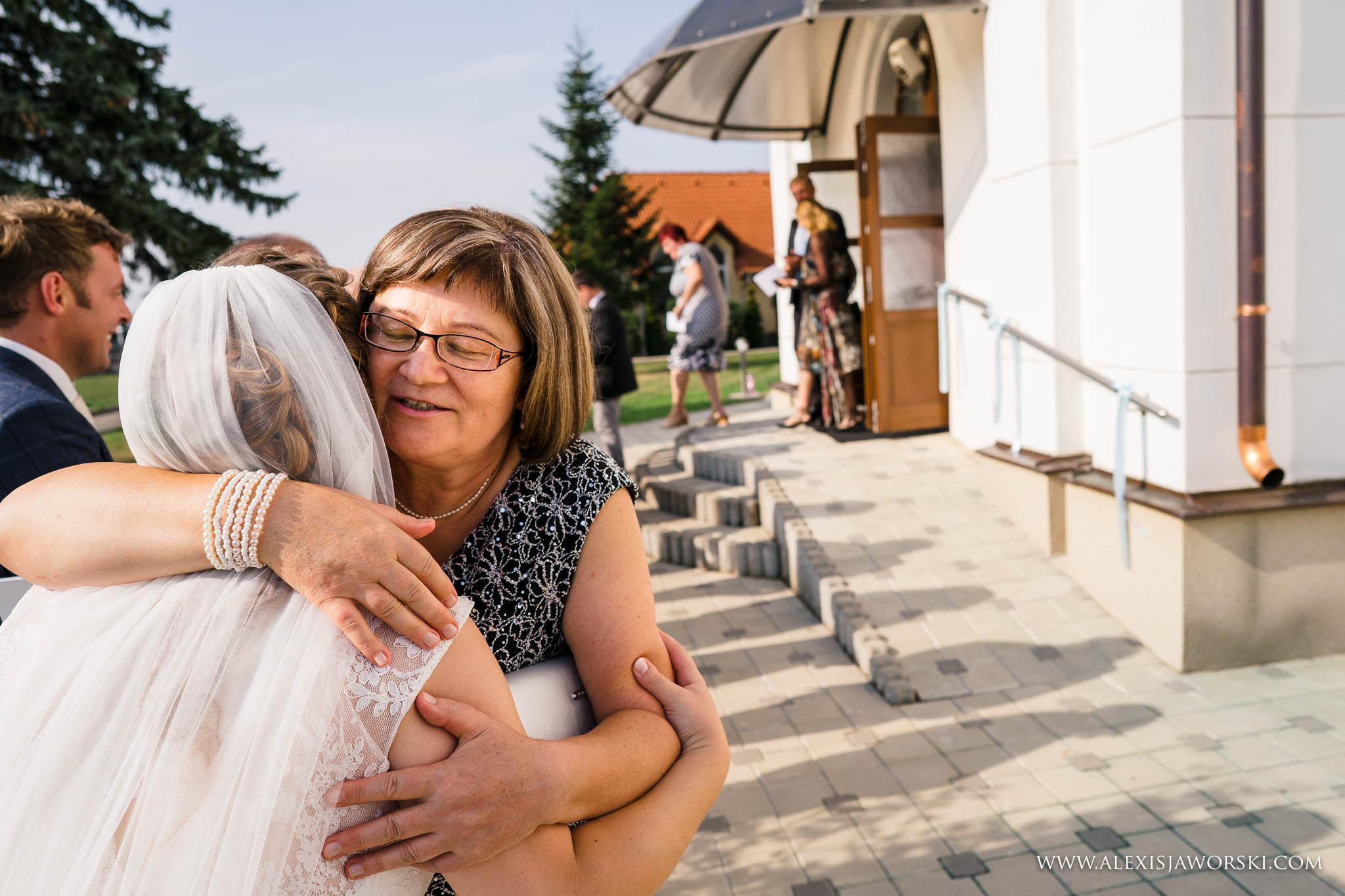 mum kissing daughter