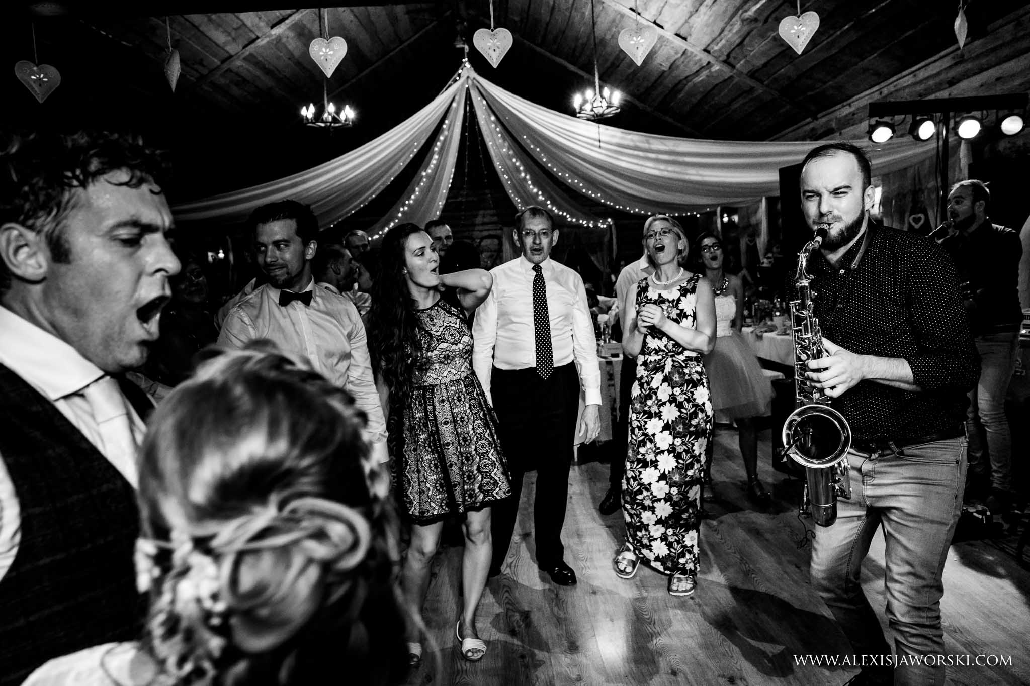 sax player serenading bride and groom