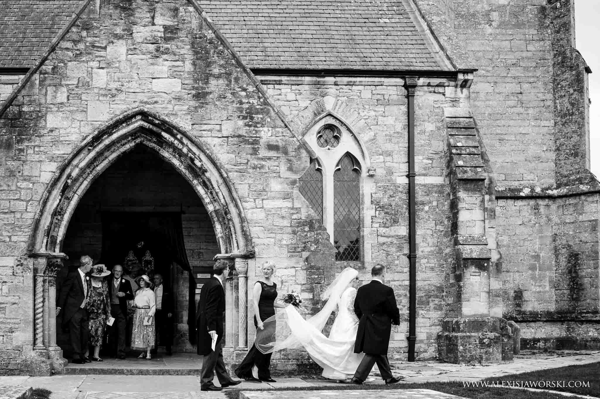 bride and groom leaving church