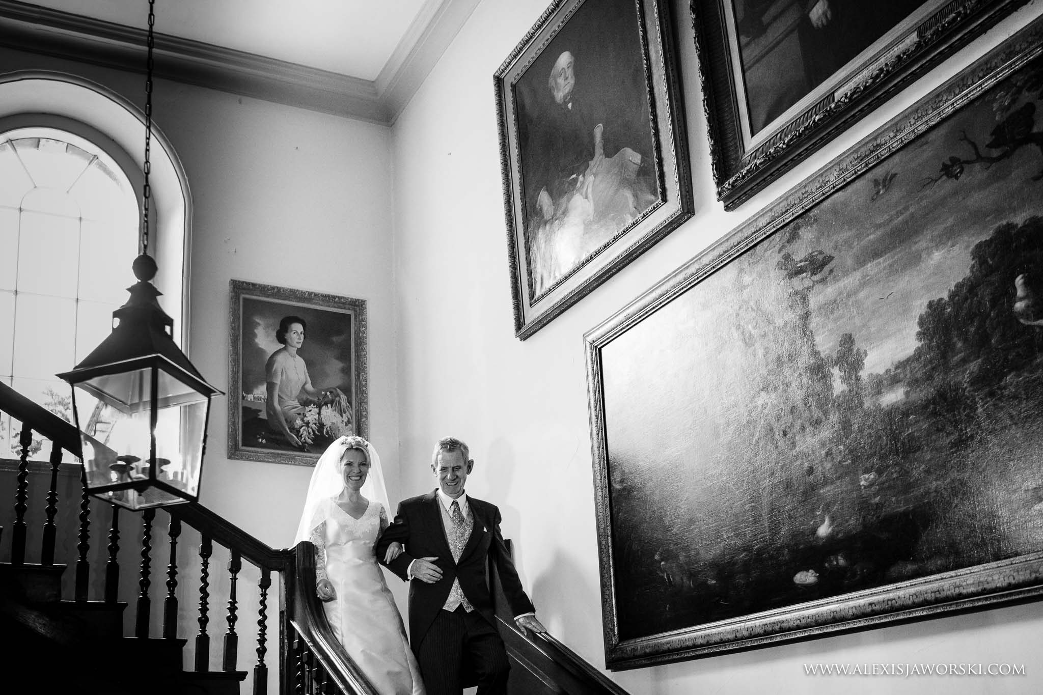 bride and dad walking down stairs