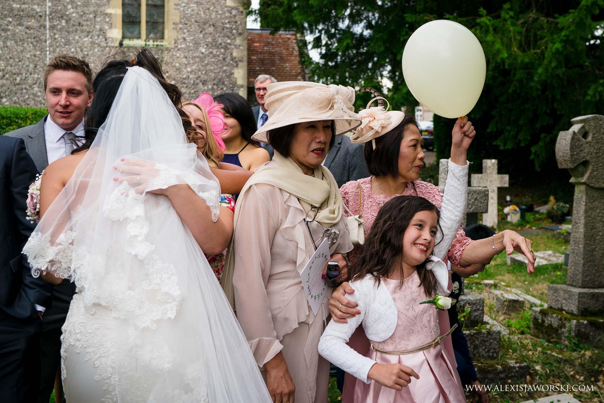 guests congratulating bride