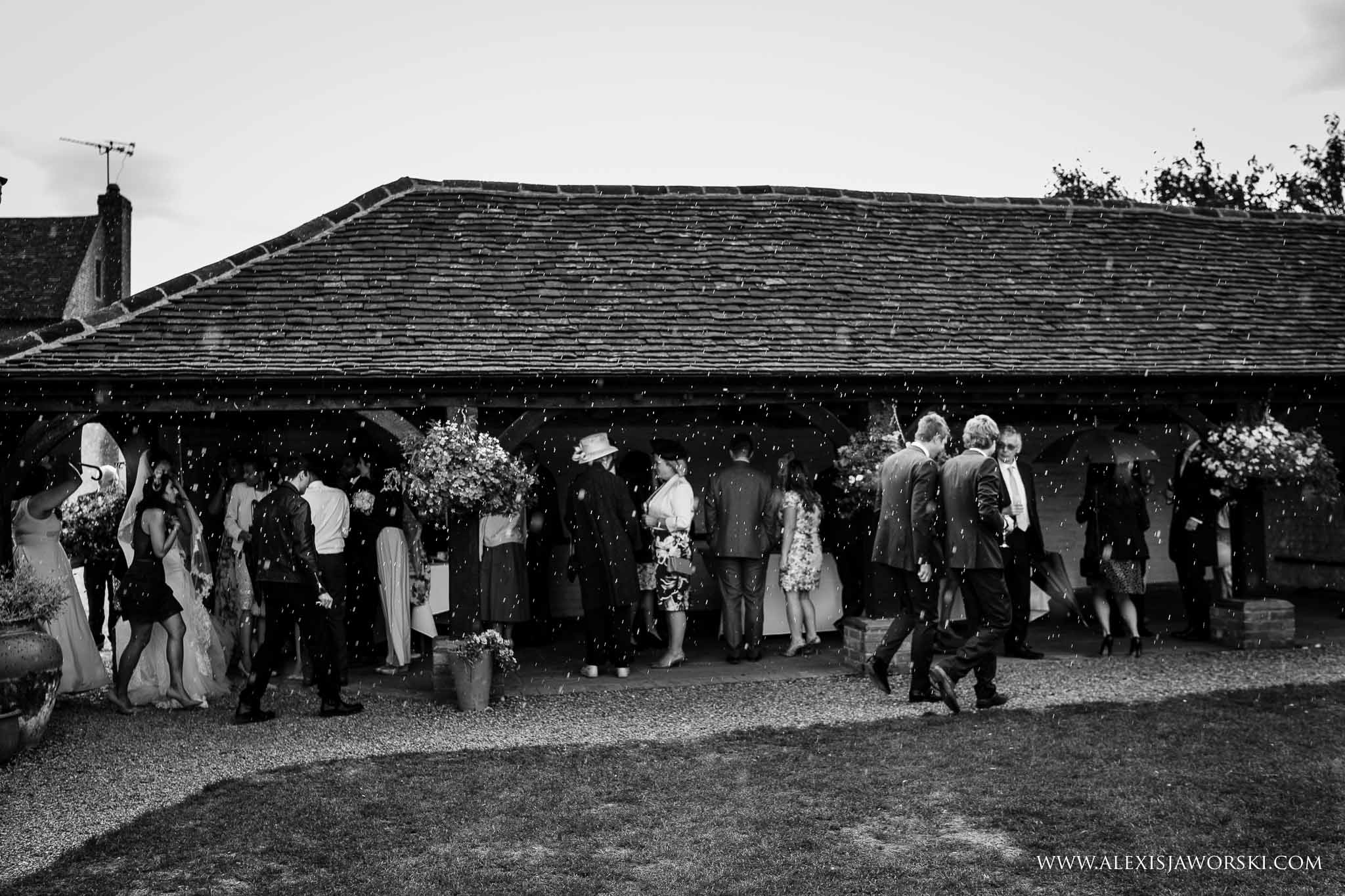 guests taking cover from rain