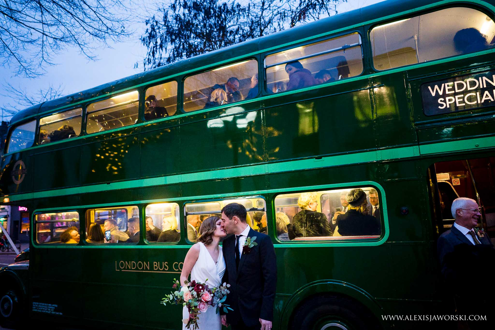 bride and groom by the bus