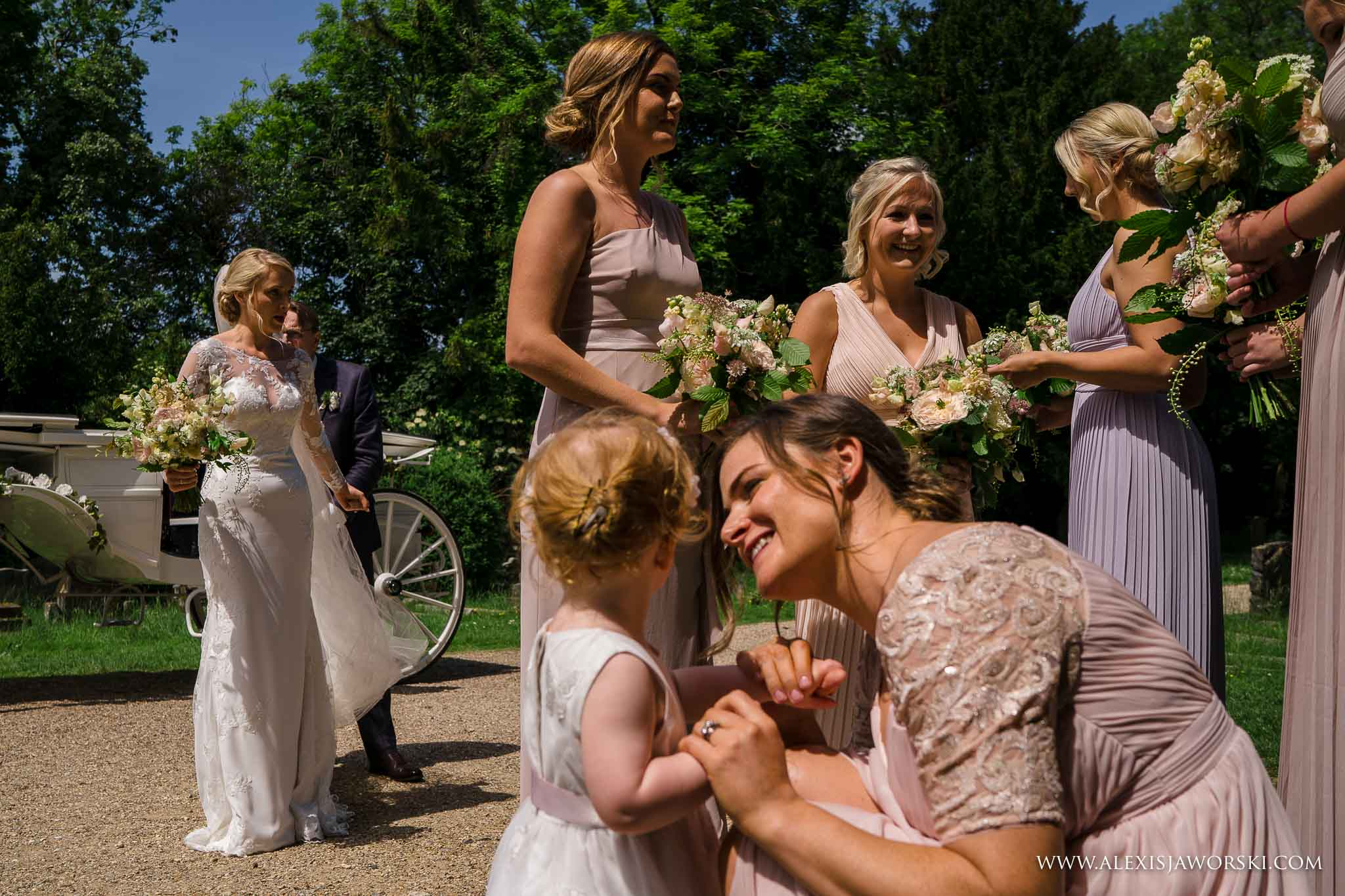 bridesmaids gathered in front of church