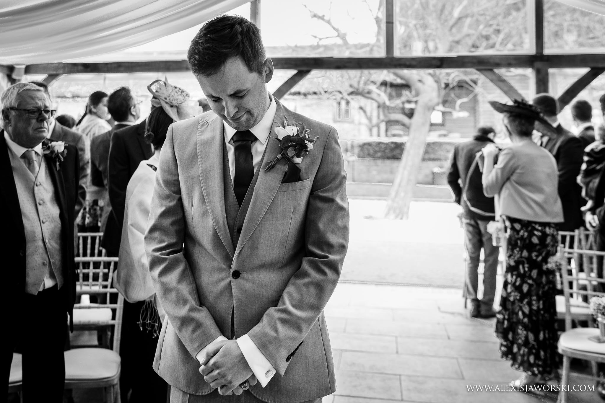 emotional groom waiting for bride