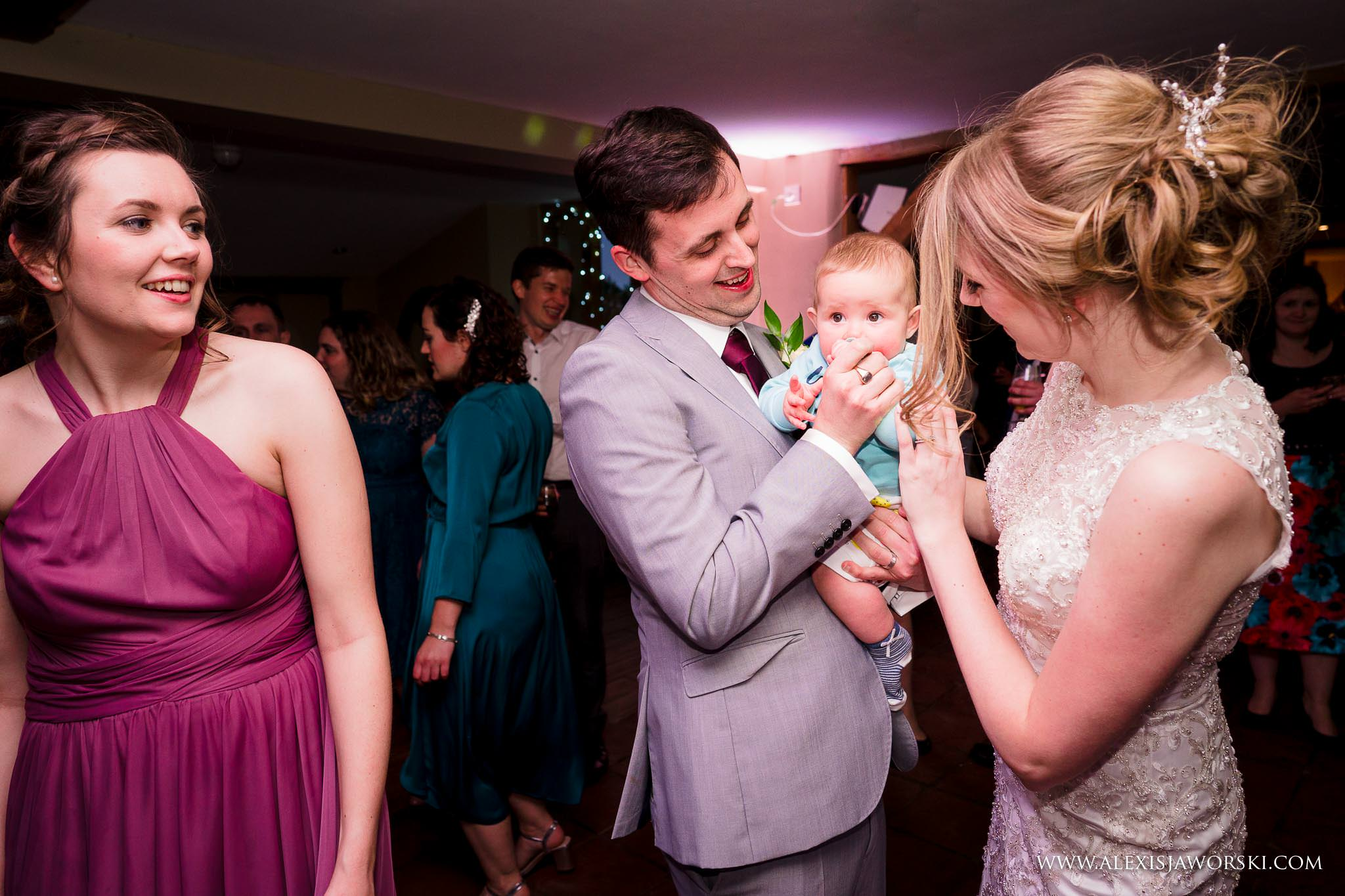 bride and groom with a baby