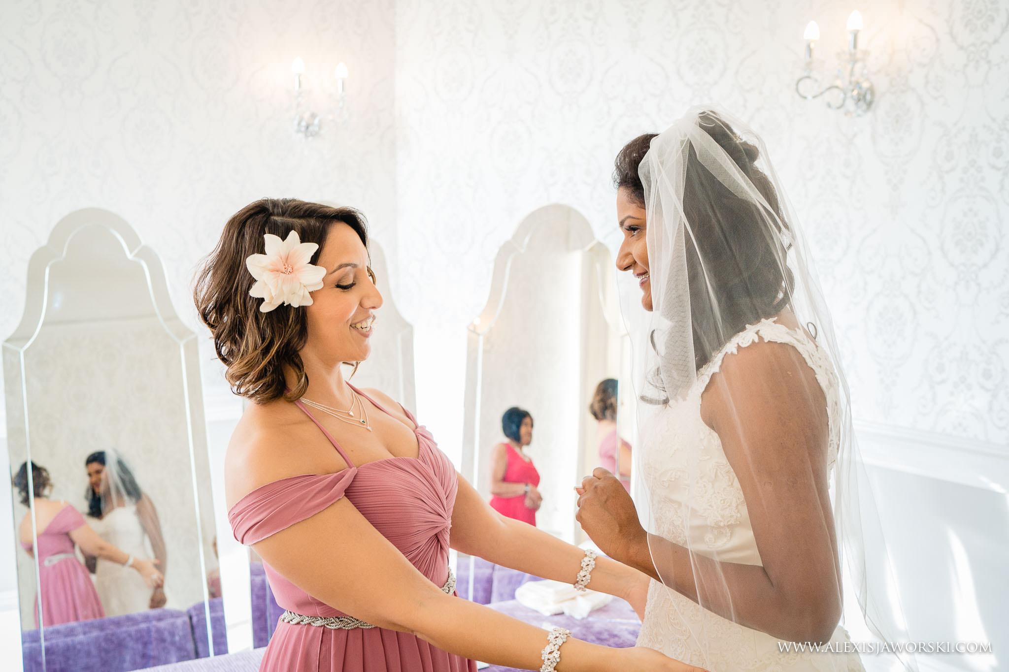 hug with bridesmaid