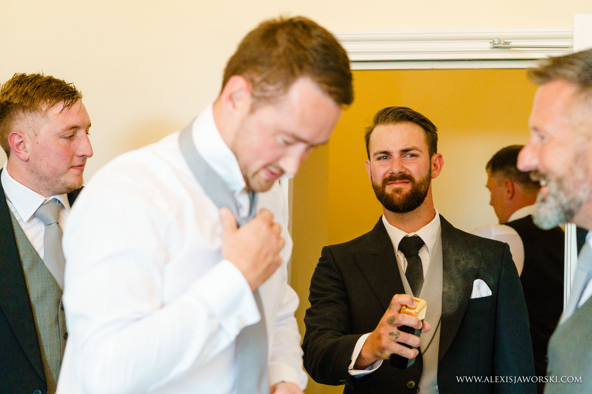 groom using perfum